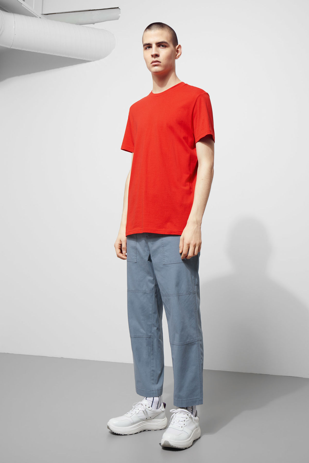 Model side image of Weekday alan t-shirt in red