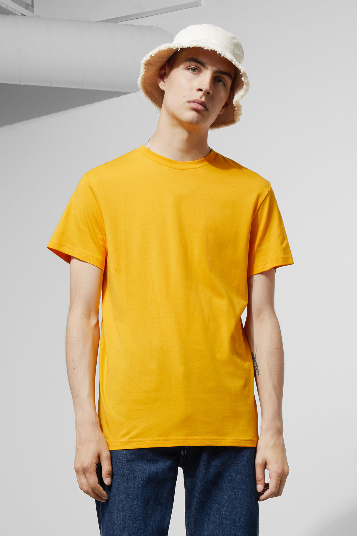 Model front image of Weekday alan t-shirt in yellow