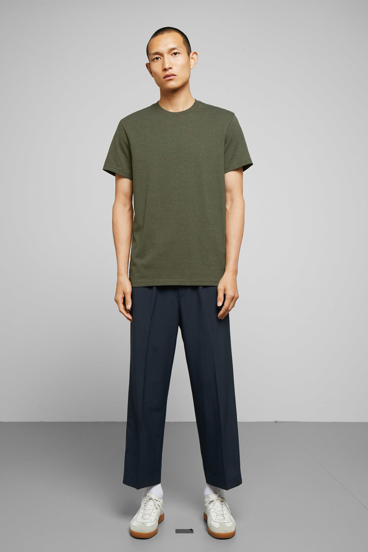 Model side image of Weekday alan t-shirt in green