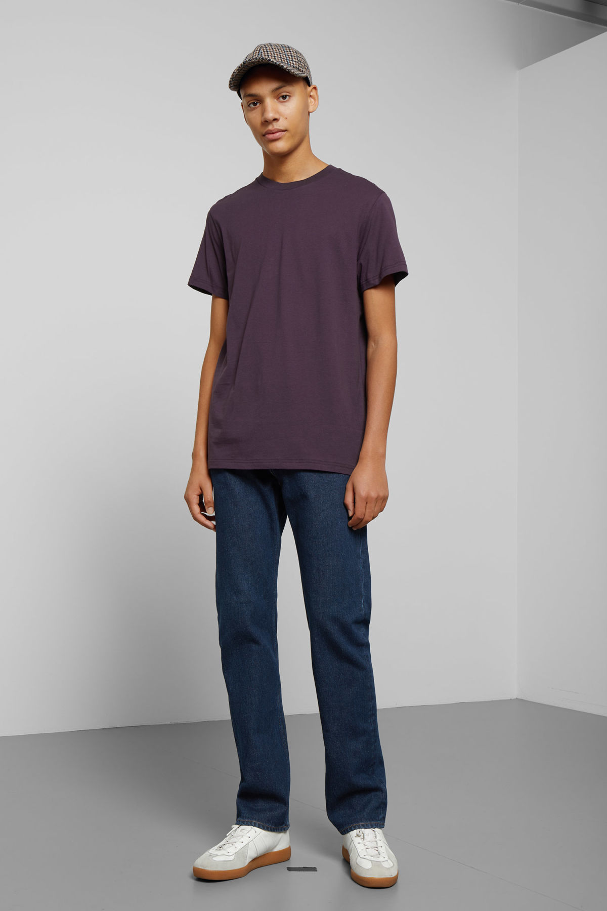 Model side image of Weekday alan t-shirt in purple