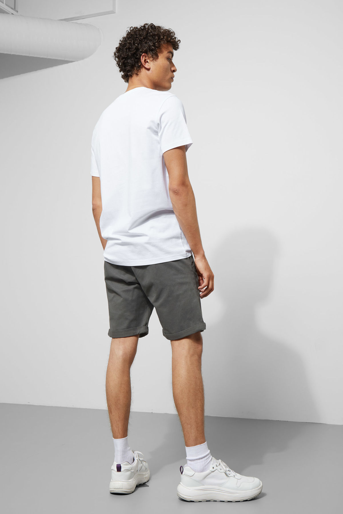 Model back image of Weekday acid shorts in grey