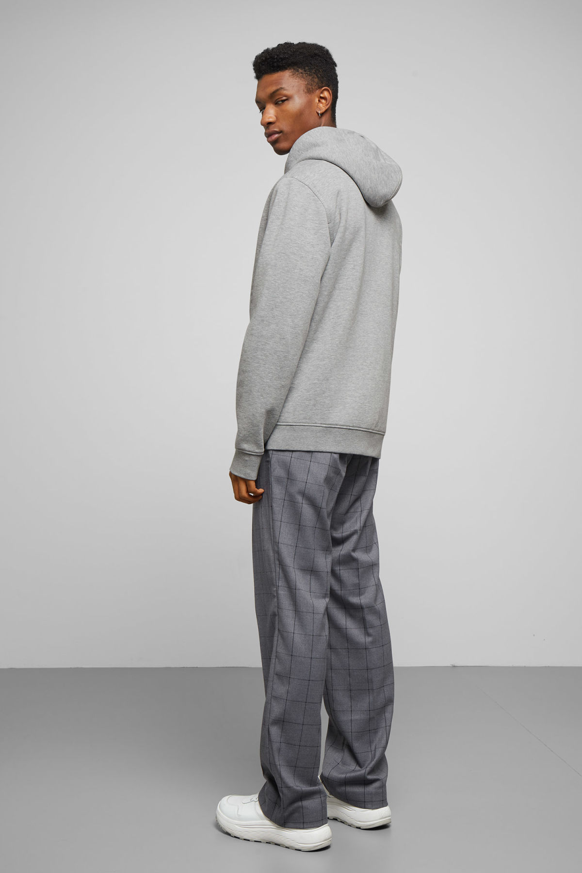 Model side image of Weekday boom zipped hoodie in grey