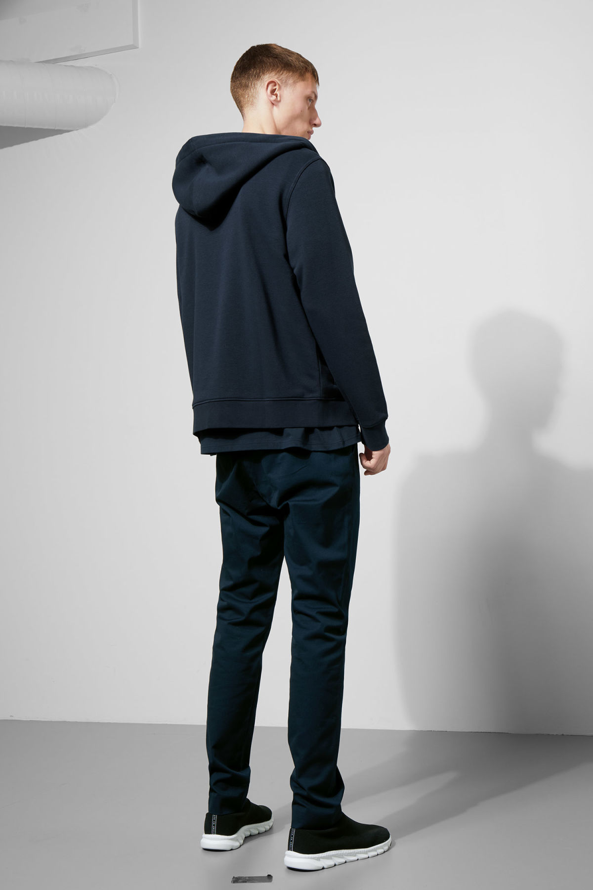 Model side image of Weekday boom zipped hoodie in blue