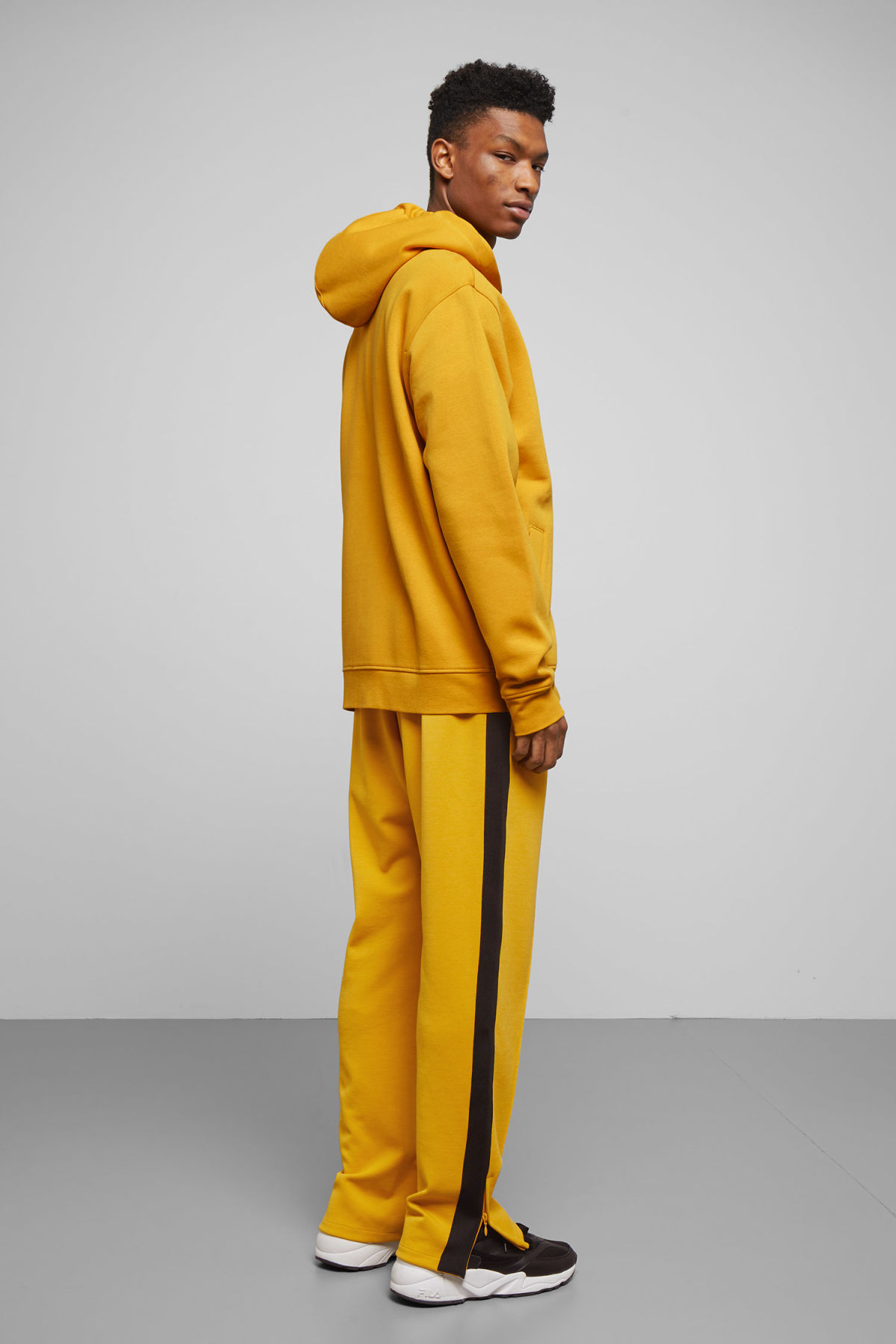Model side image of Weekday boom zipped hoodie in yellow
