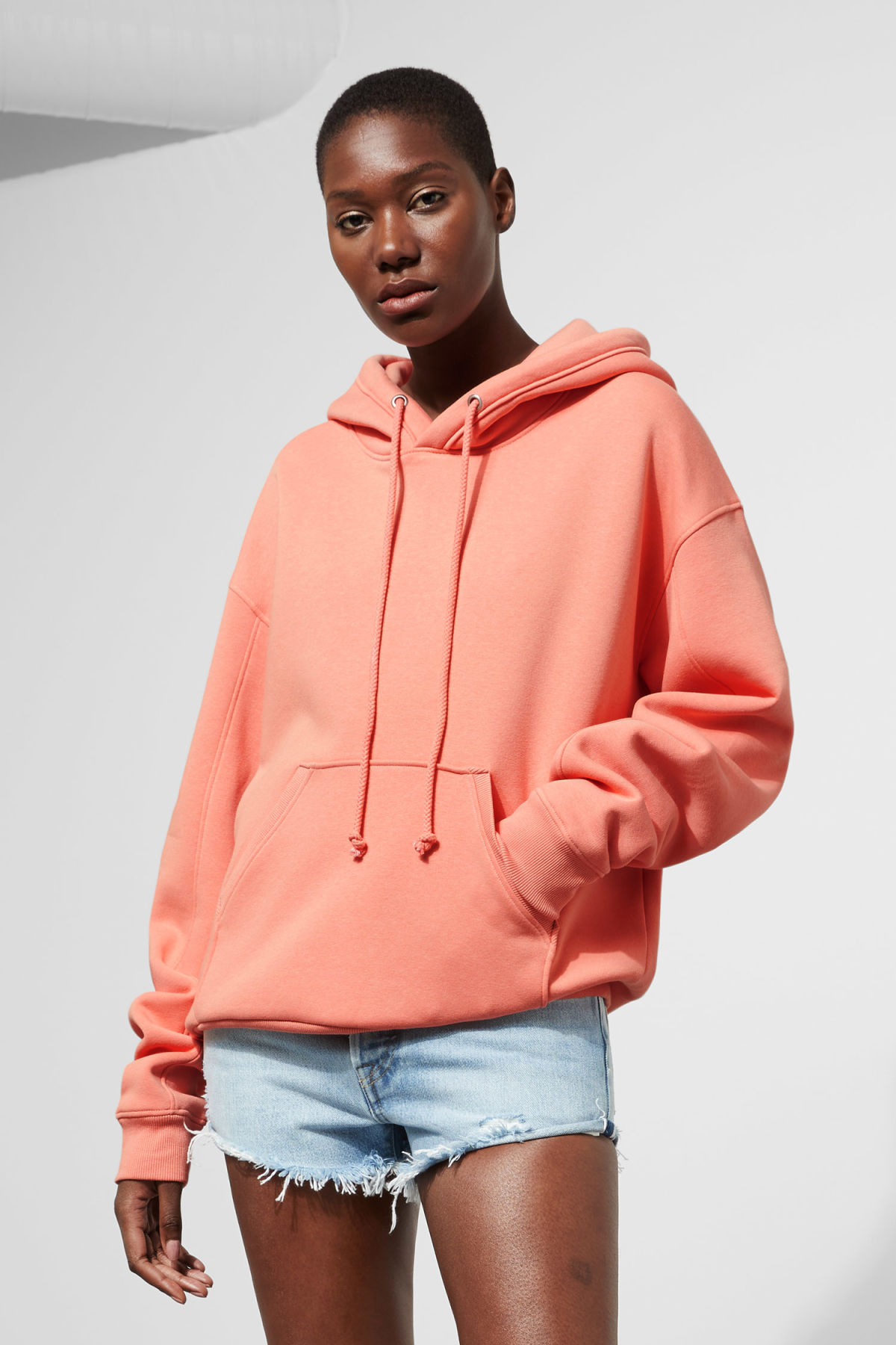 Model front image of Weekday ailin hooded sweatshirt in orange