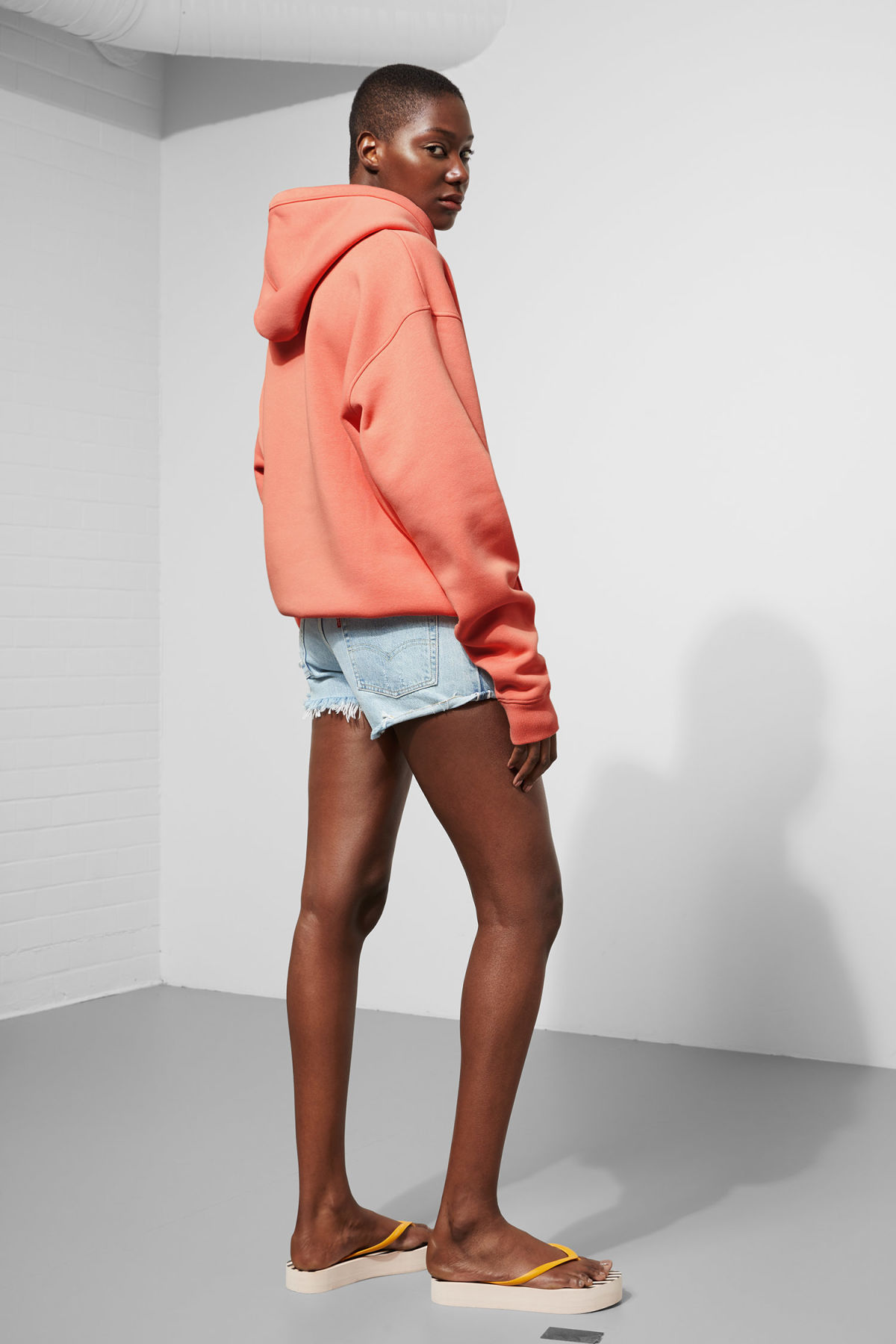Model back image of Weekday ailin hooded sweatshirt in orange