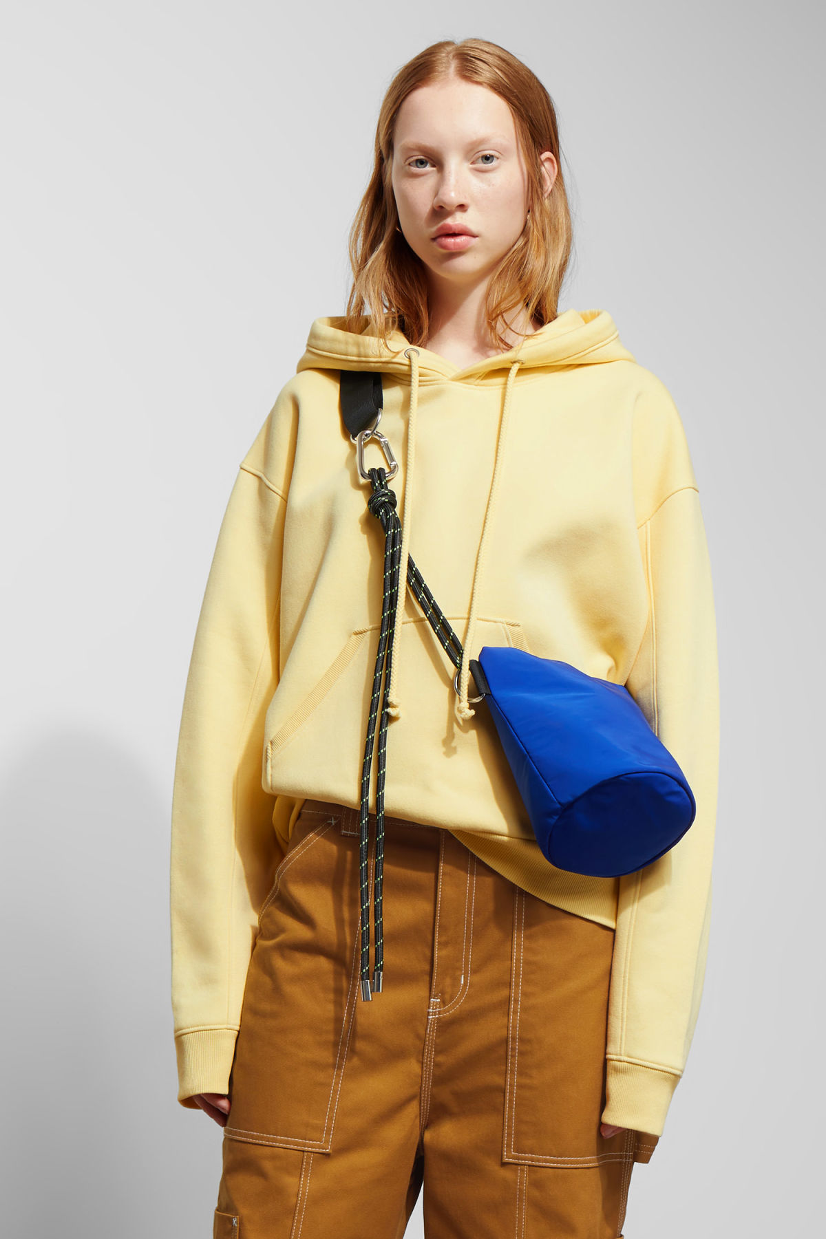 Model front image of Weekday ailin hooded sweatshirt in yellow