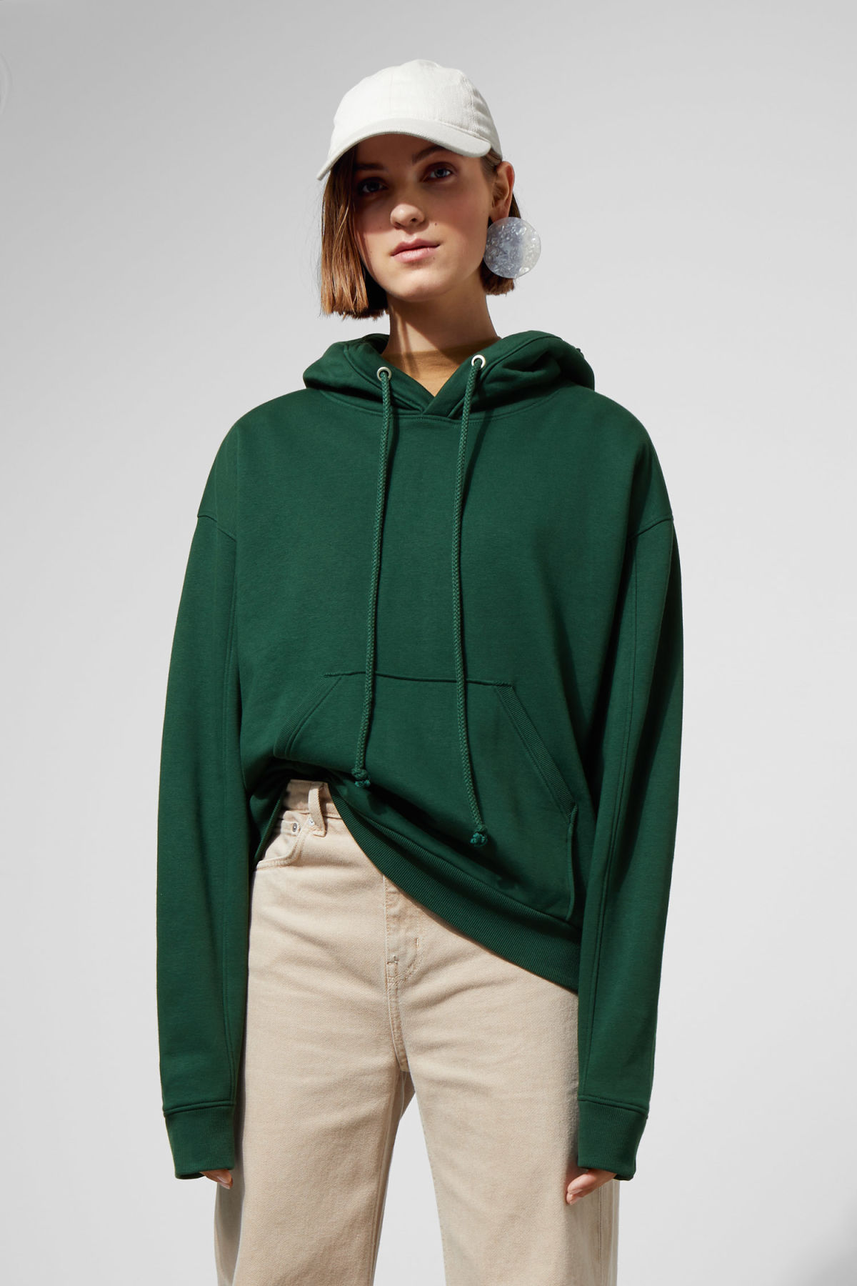 Model front image of Weekday ailin hooded sweatshirt in green