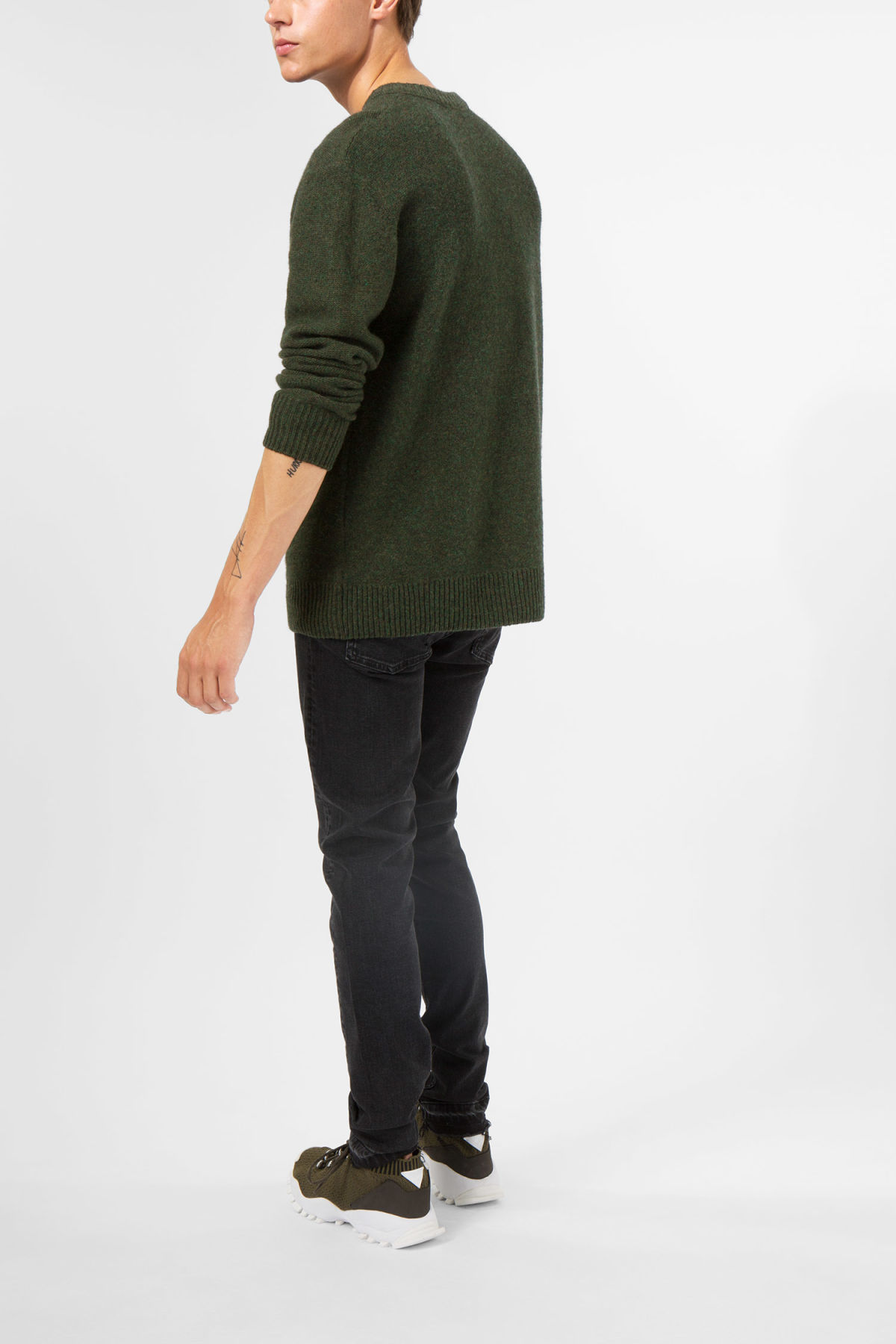 Model side image of Weekday knit sweater  in green