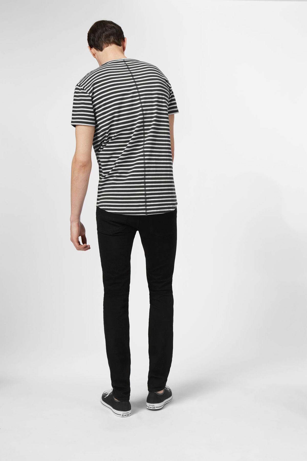 Model side image of Weekday rumour striped t-shirt in grey