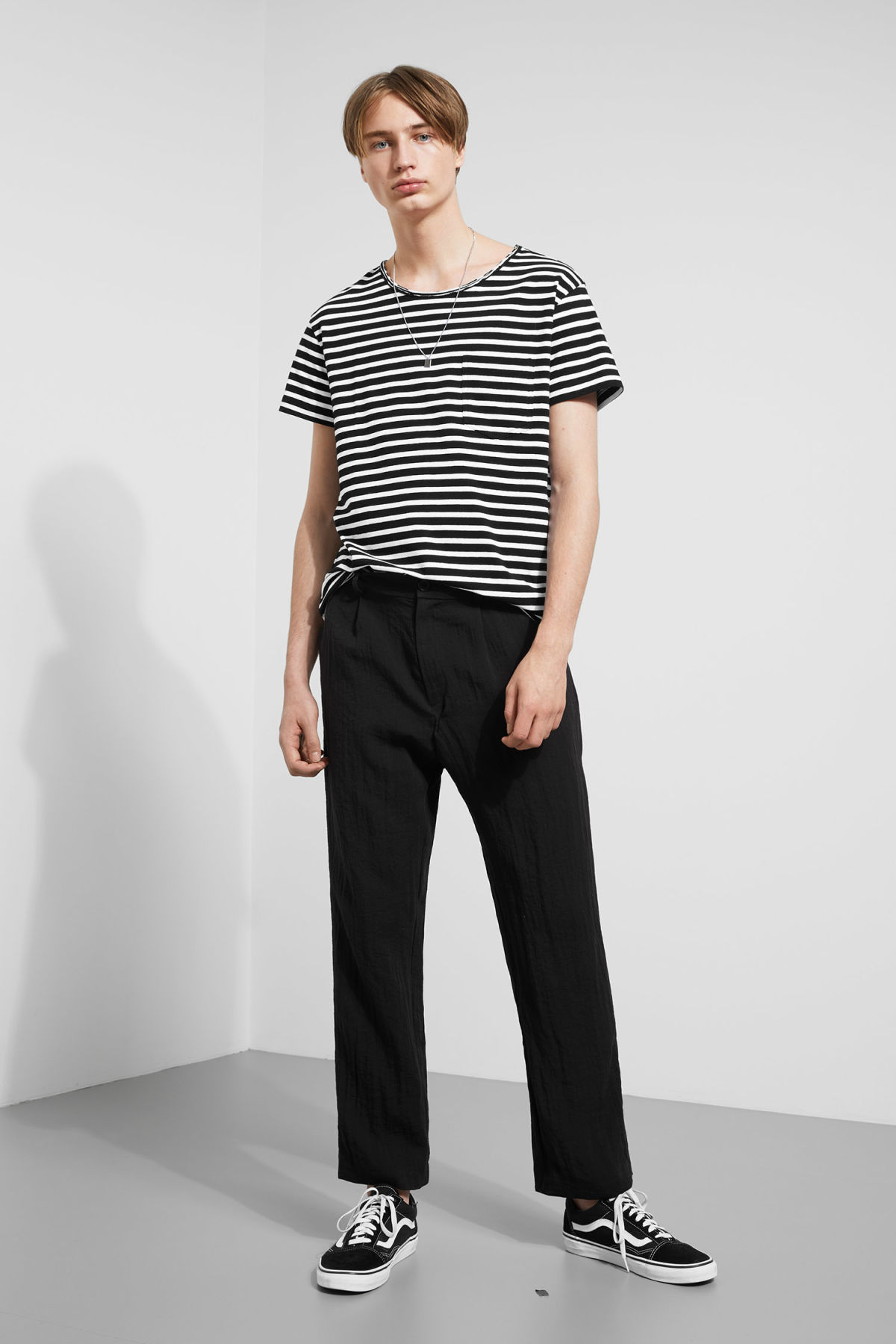 Model side image of Weekday rumour striped t-shirt in black