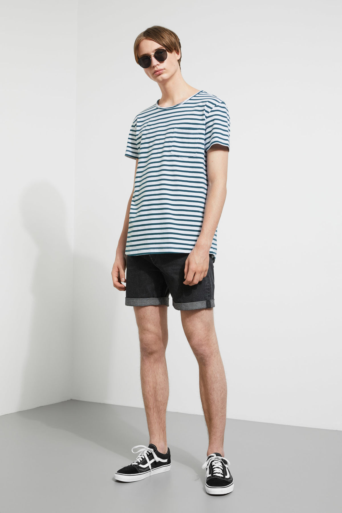 Model side image of Weekday rumour striped t-shirt in blue