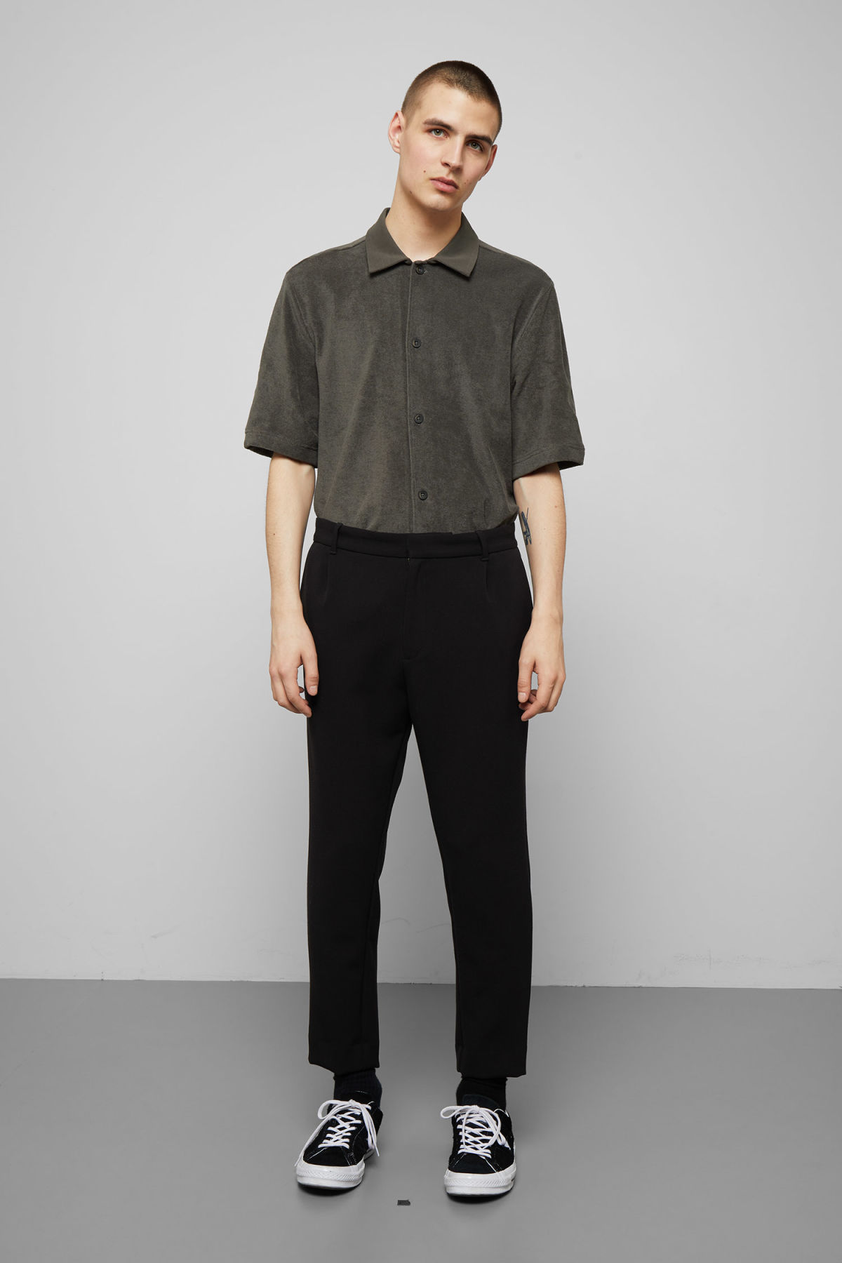 Model side image of Weekday mard trousers in black