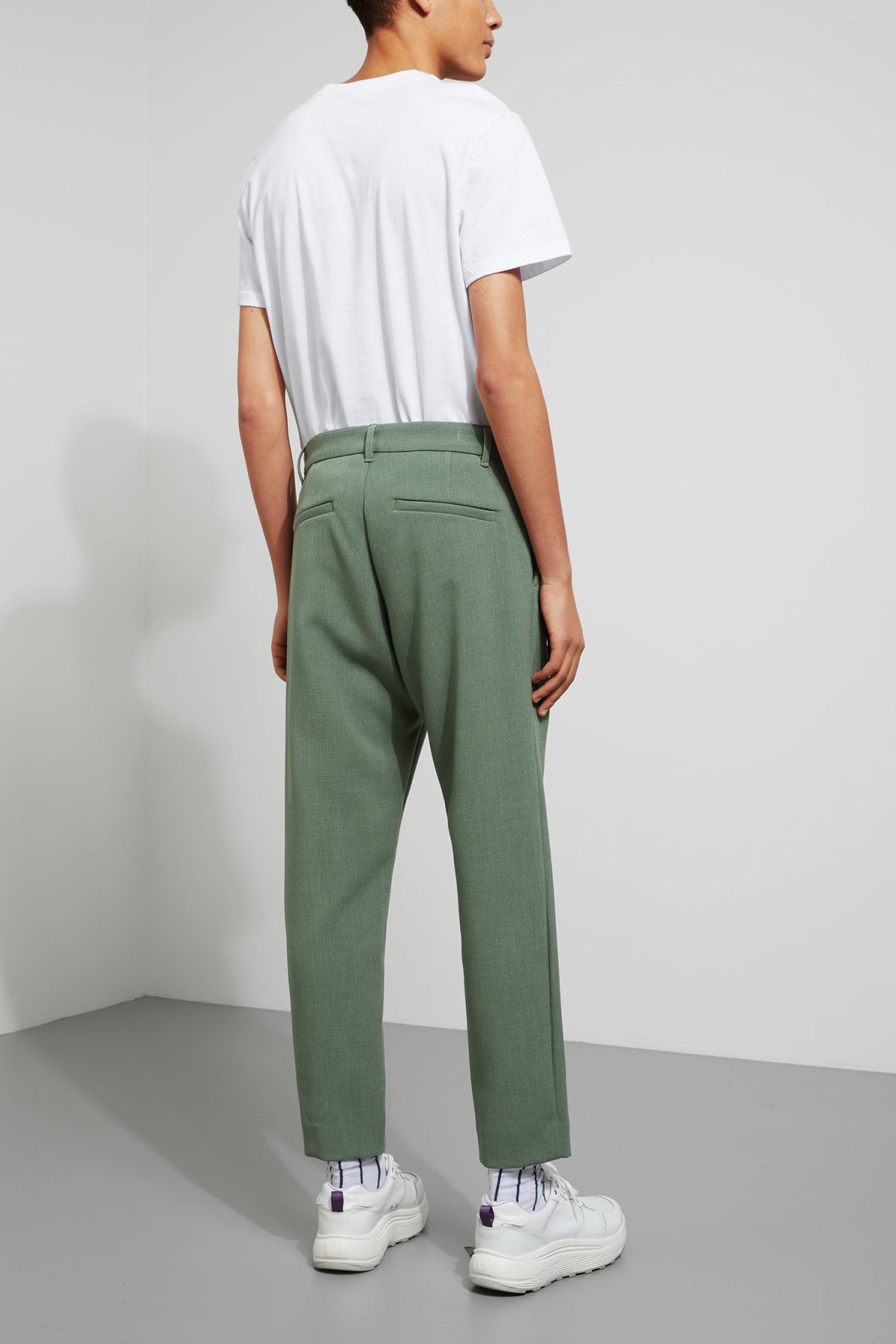 Model side image of Weekday mard trousers in green