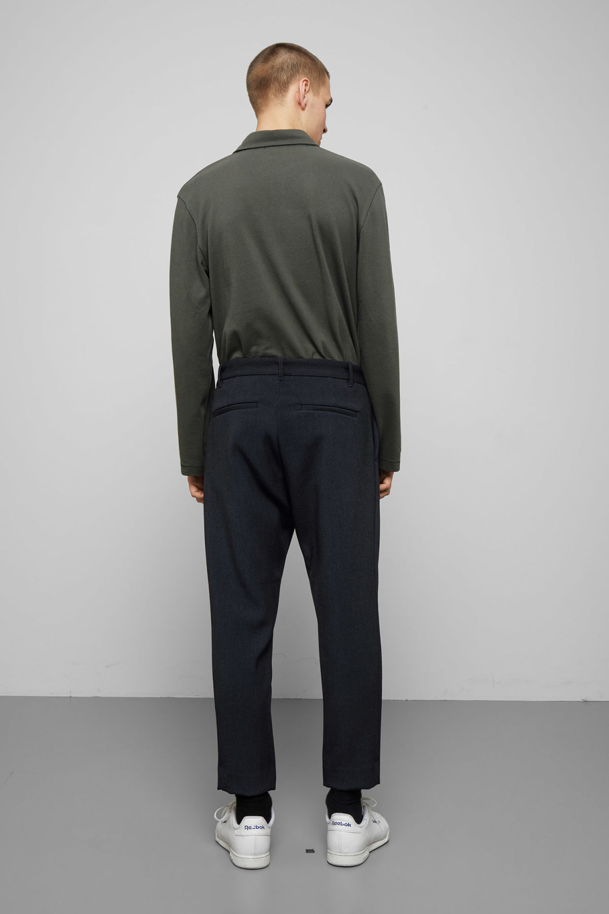 Model side image of Weekday mard trousers in blue