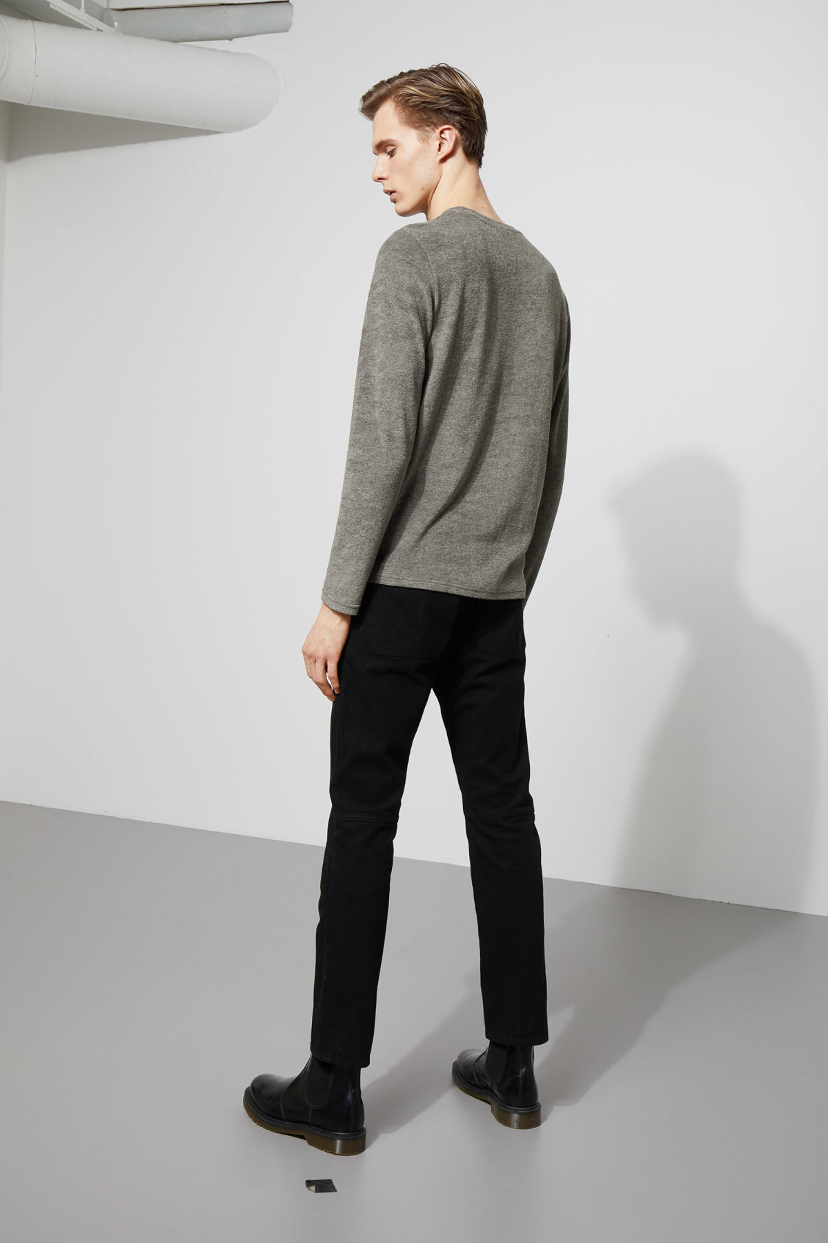 Model side image of Weekday towel long sleeve in grey