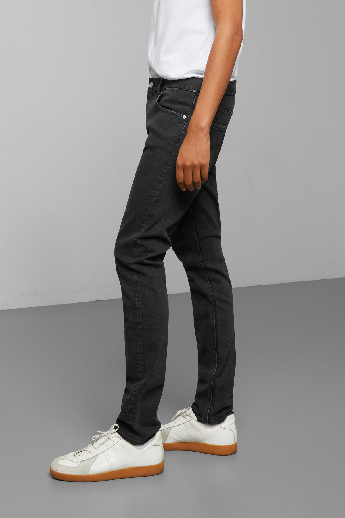 Model side image of Weekday friday tuned black jeans in black