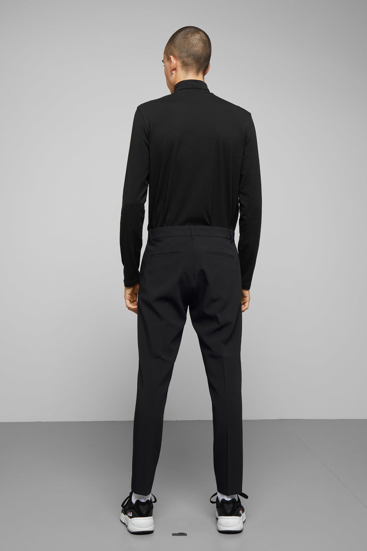 Model back image of Weekday riffle trousers  in black
