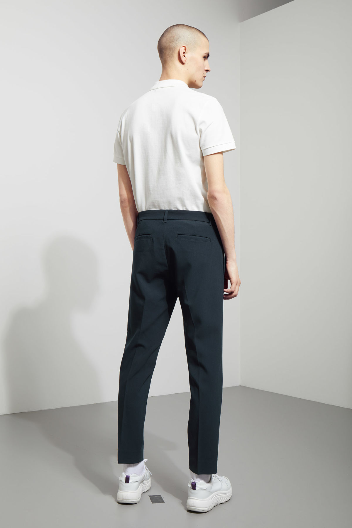 Model back image of Weekday riffle trousers  in blue