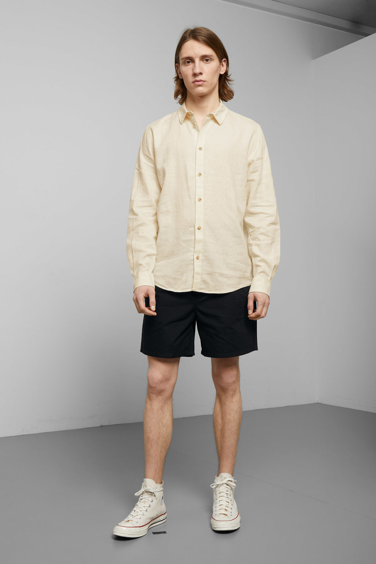 Model side image of Weekday lead linen shirt in white