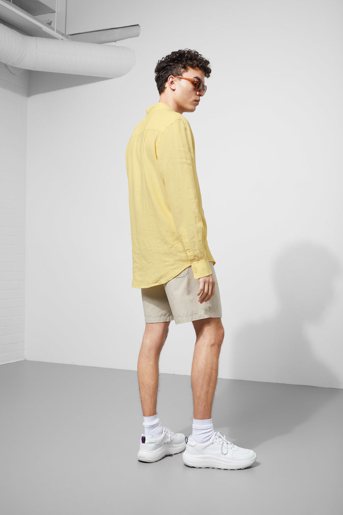 Model back image of Weekday lead linen shirt in yellow