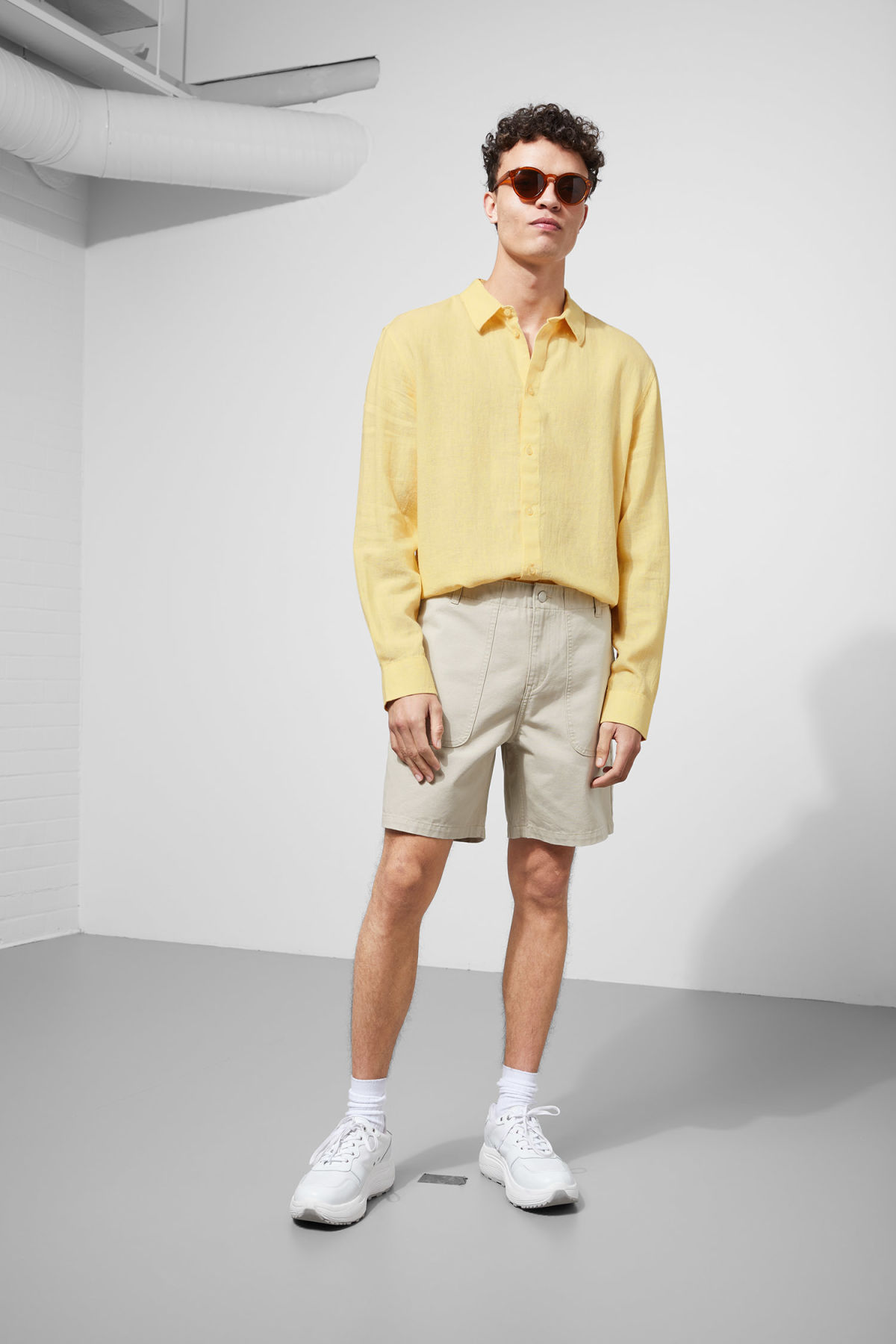 Model side image of Weekday lead linen shirt in yellow