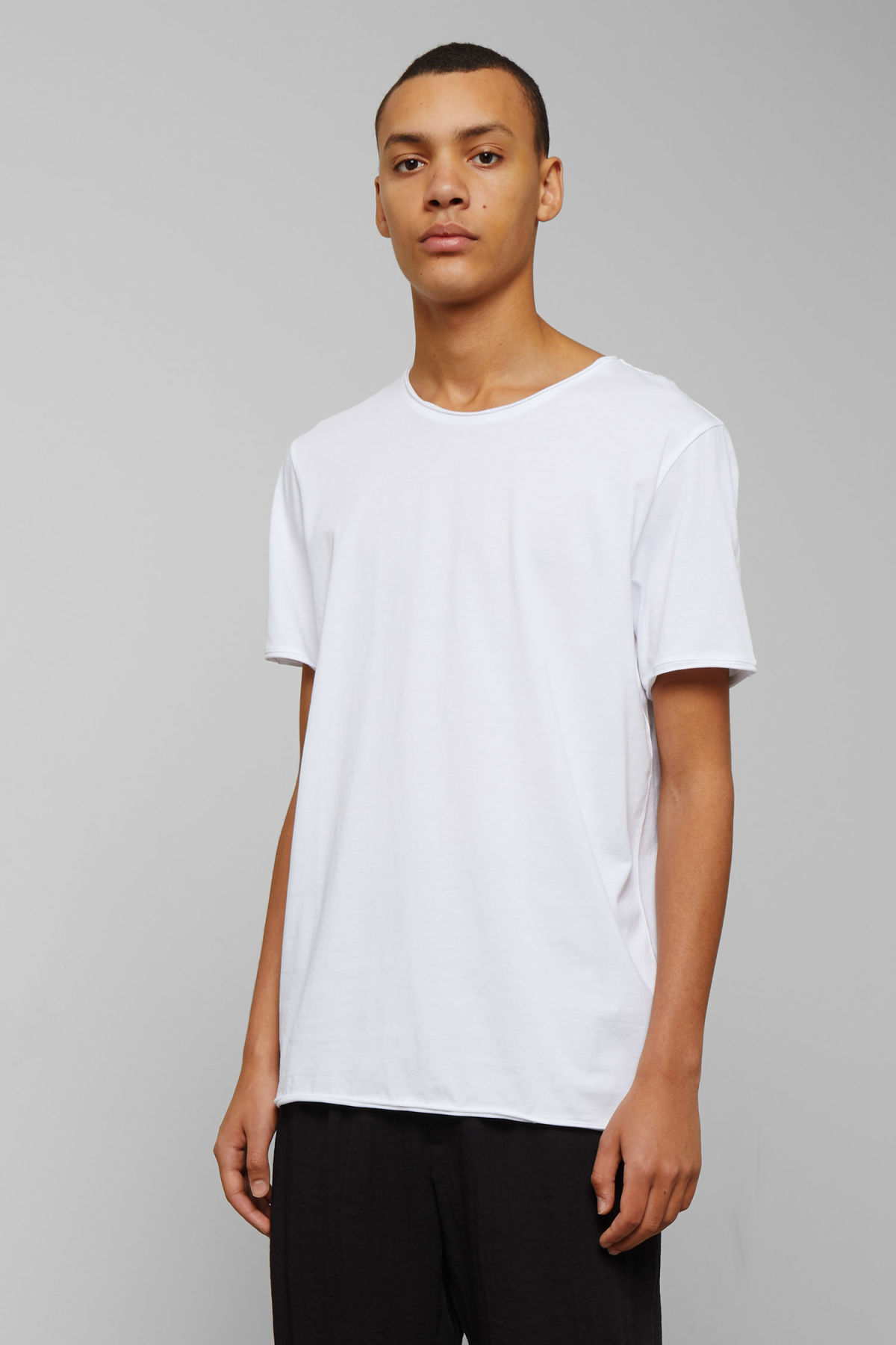 Model front image of Weekday dark t-shirt in white