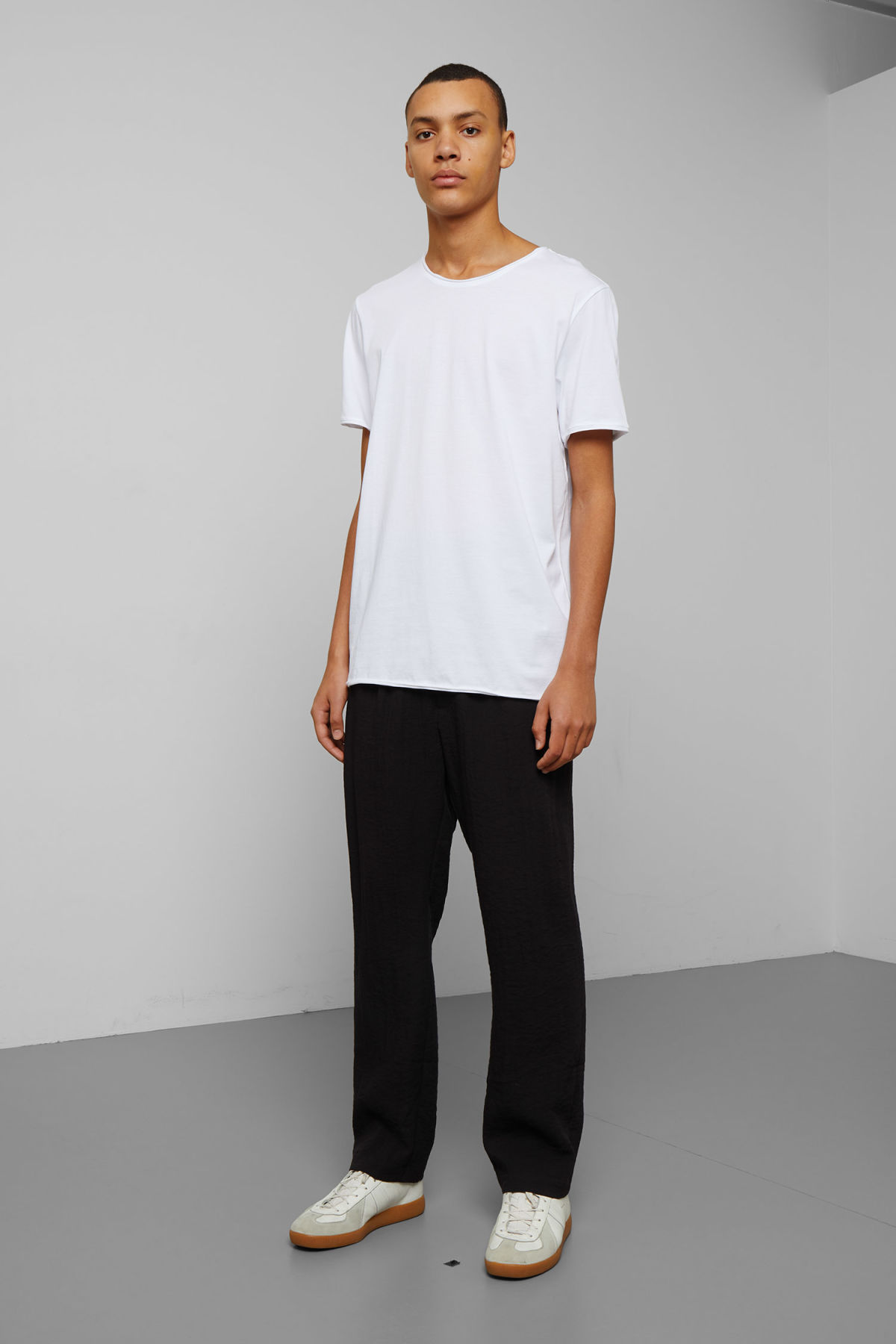 Model side image of Weekday dark t-shirt in white