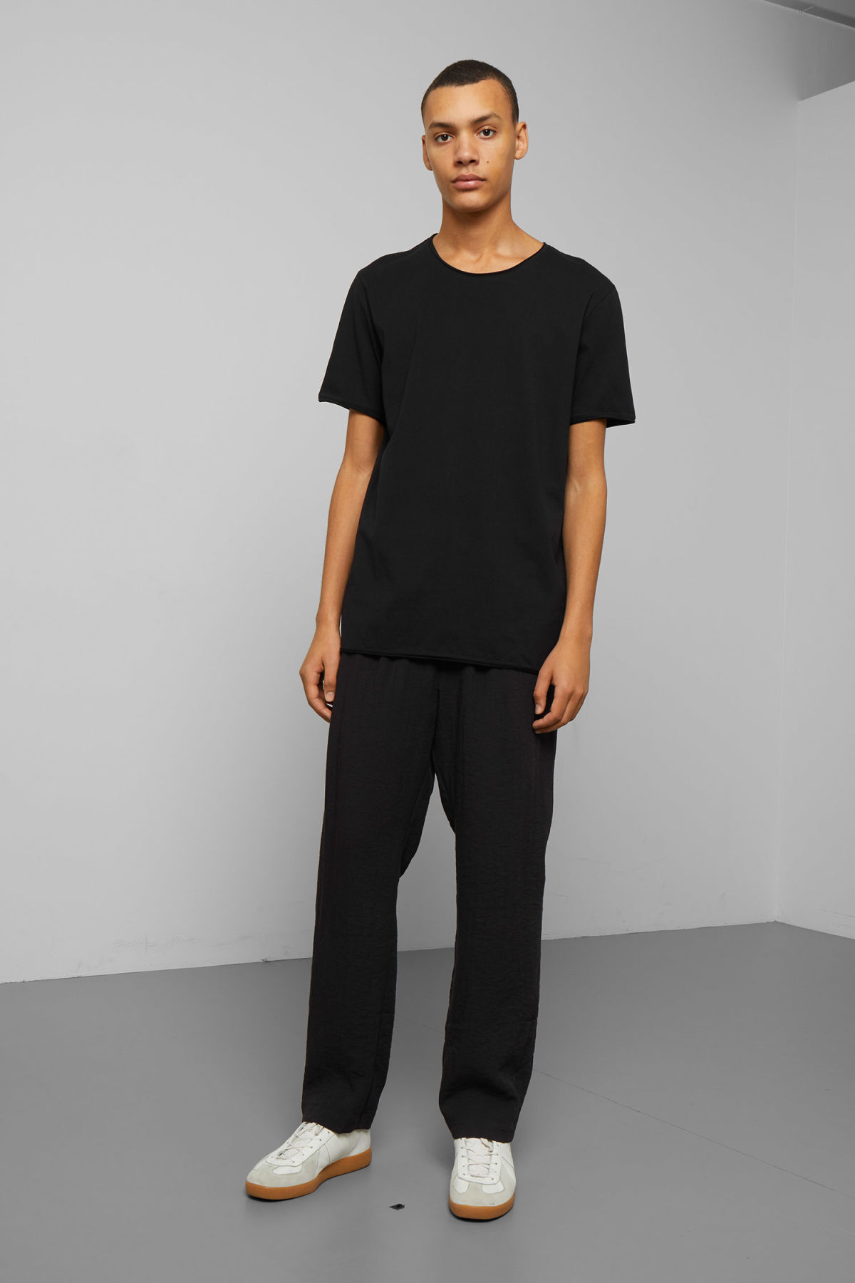 Model side image of Weekday dark t-shirt in black