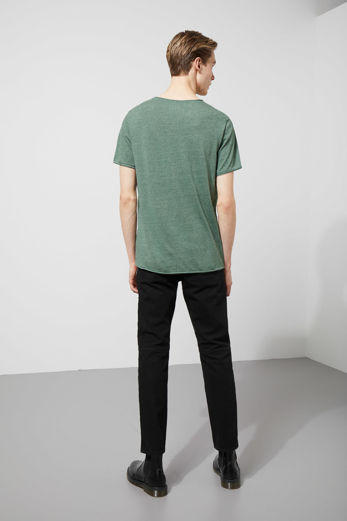 Model side image of Weekday dark t-shirt in turquoise