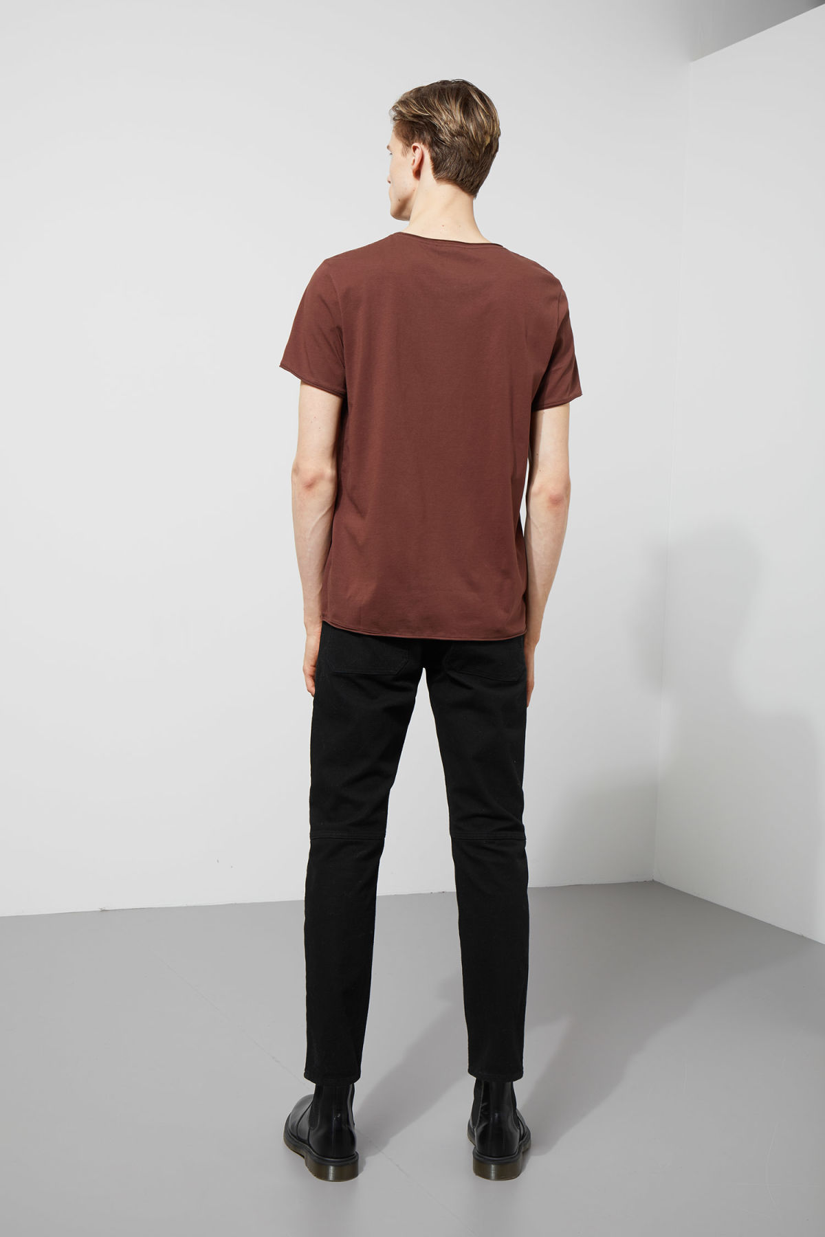 Model side image of Weekday dark t-shirt in brown