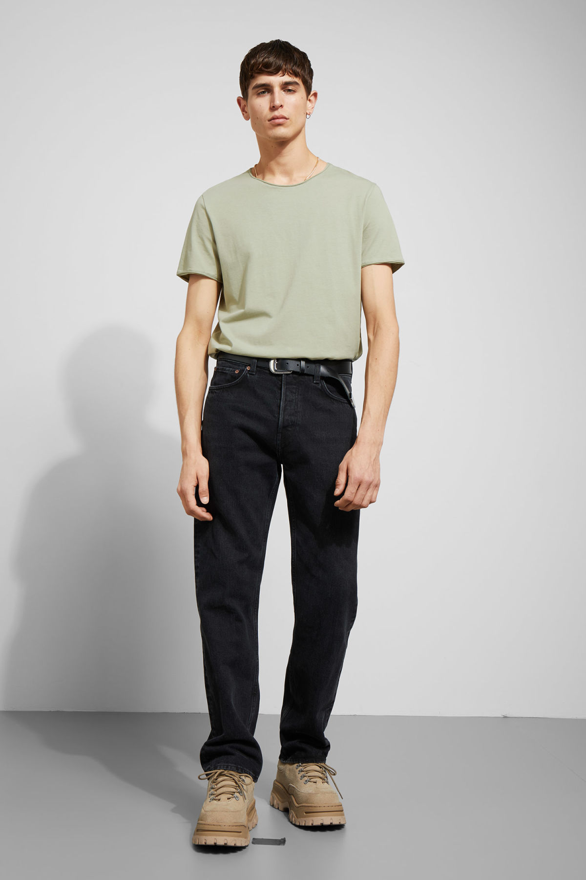 Model side image of Weekday dark t-shirt in green
