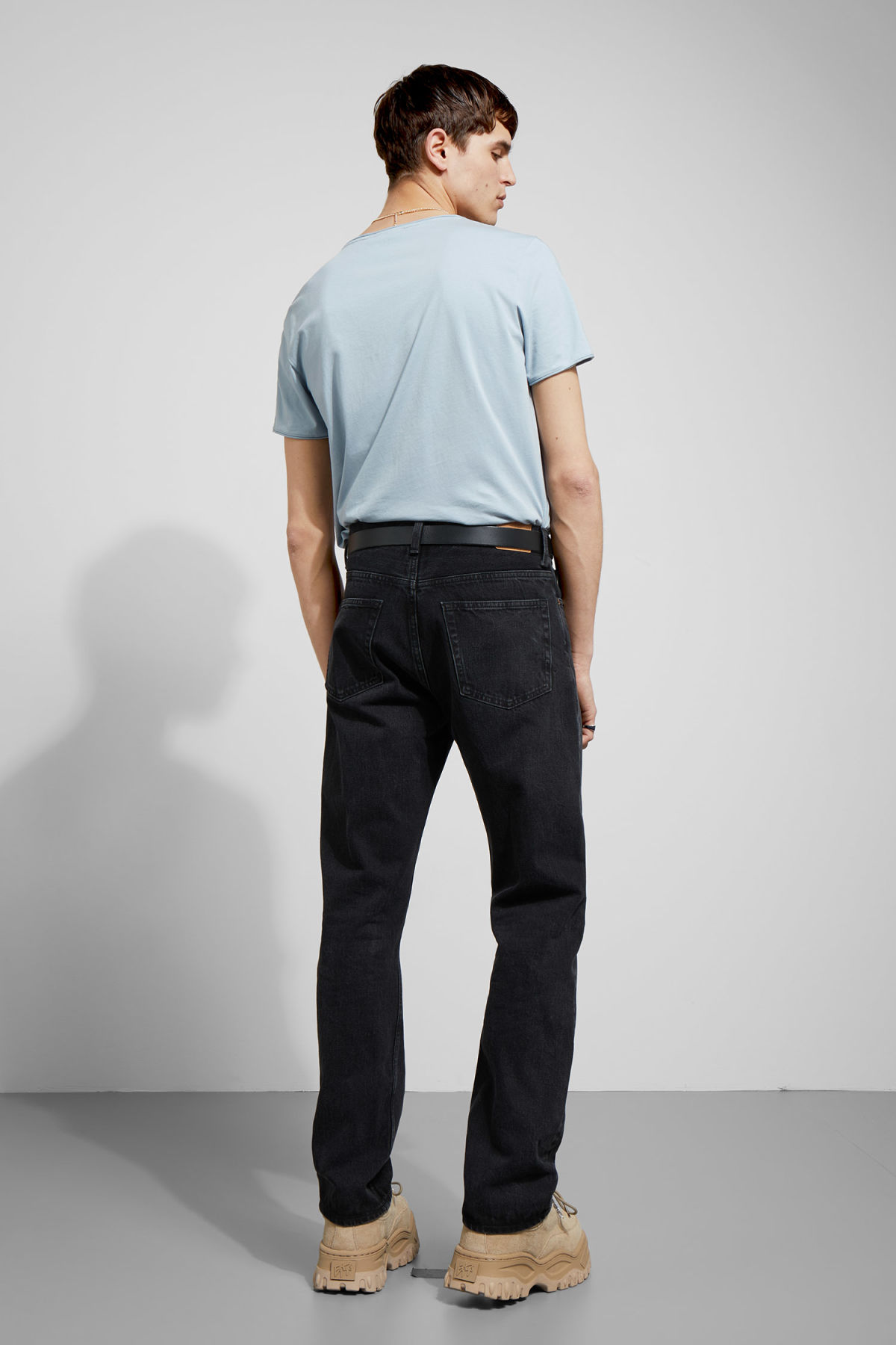 Model back image of Weekday dark t-shirt in blue