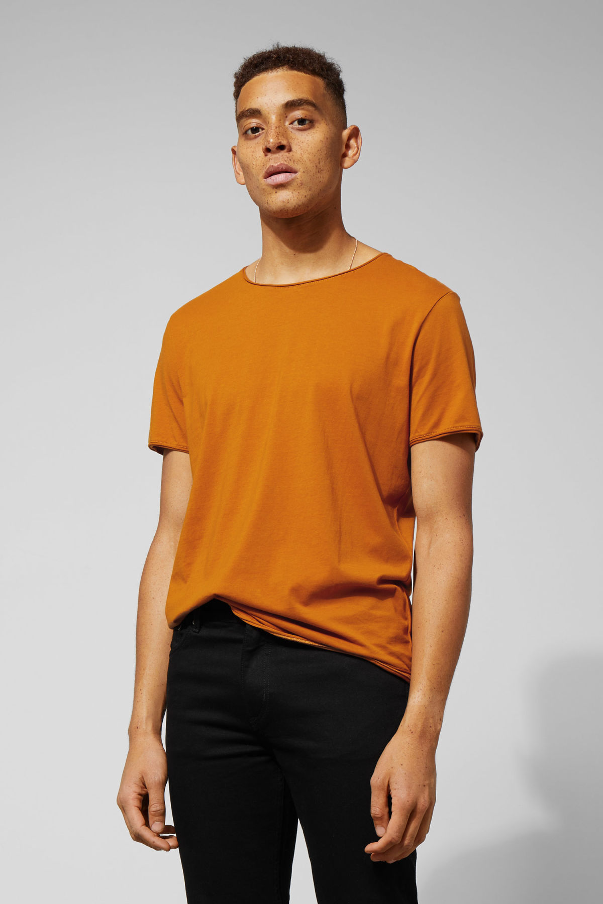 Model front image of Weekday dark t-shirt in yellow