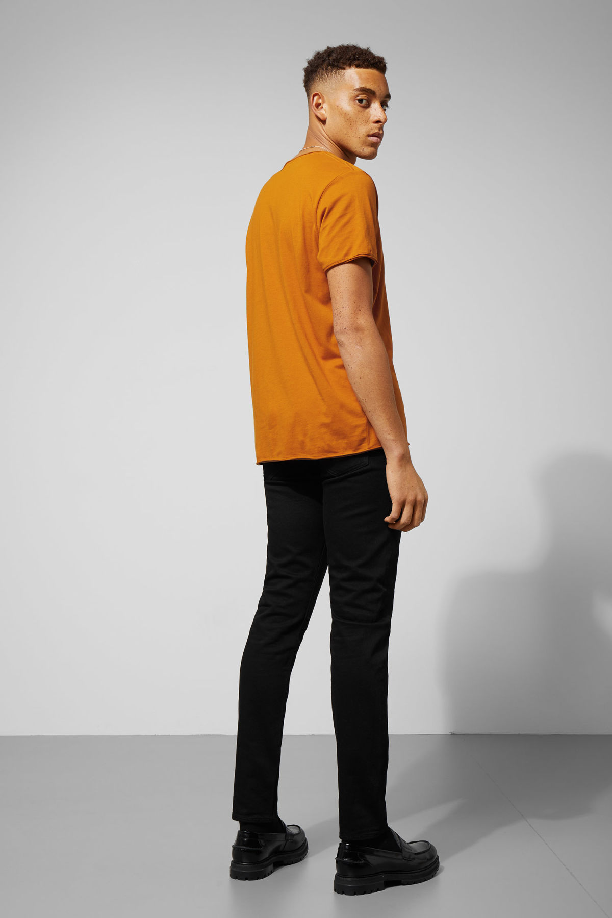 Model back image of Weekday dark t-shirt in yellow