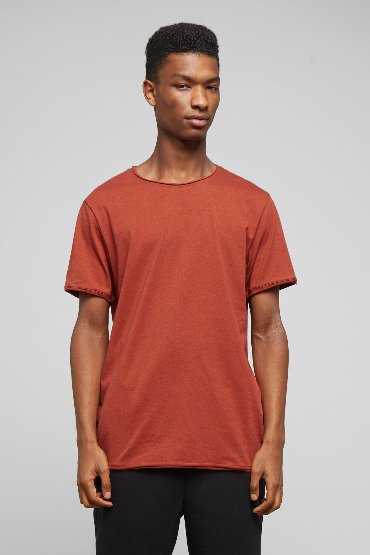 Model front image of Weekday dark t-shirt in orange