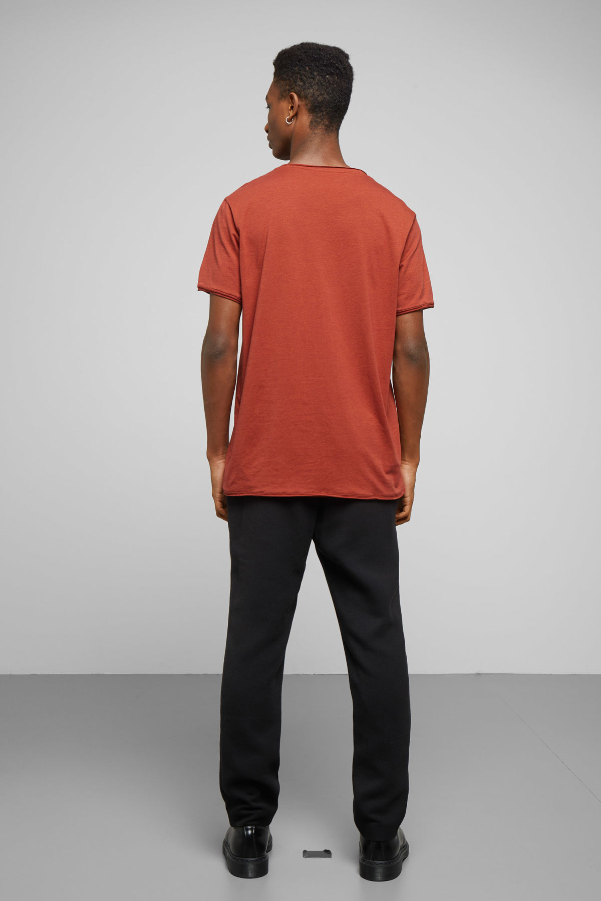 Model side image of Weekday dark t-shirt in orange
