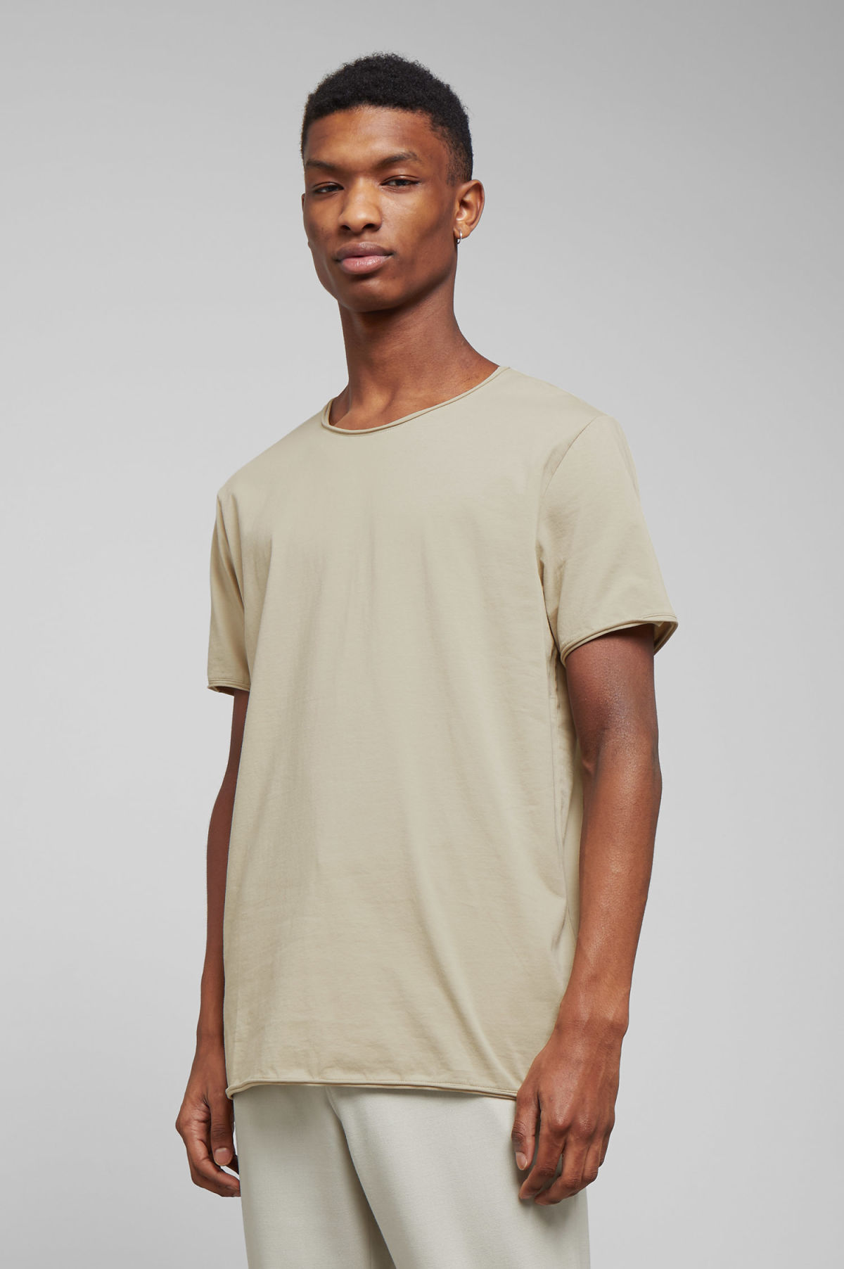 Model front image of Weekday dark t-shirt in beige