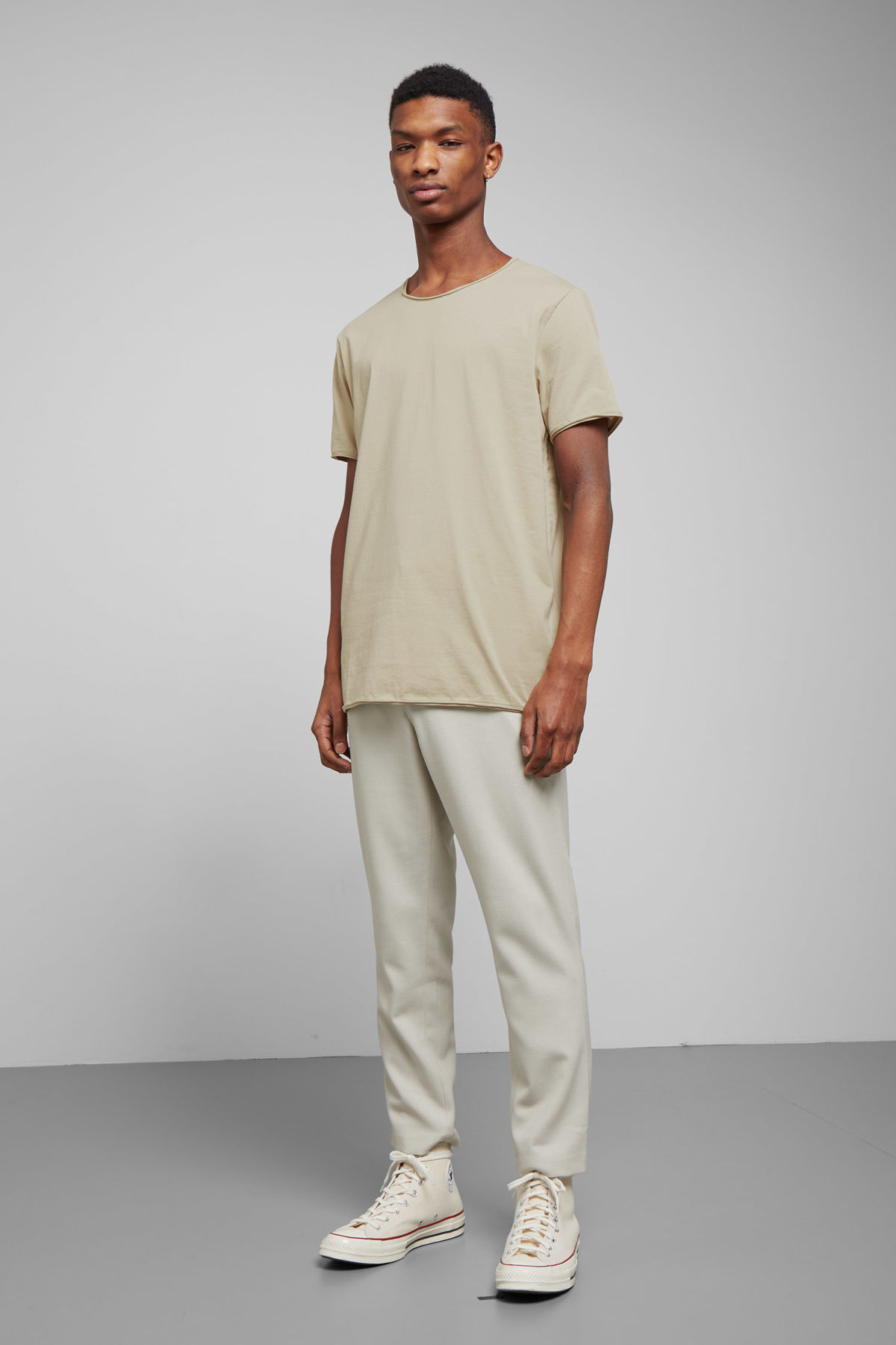 Model side image of Weekday dark t-shirt in beige