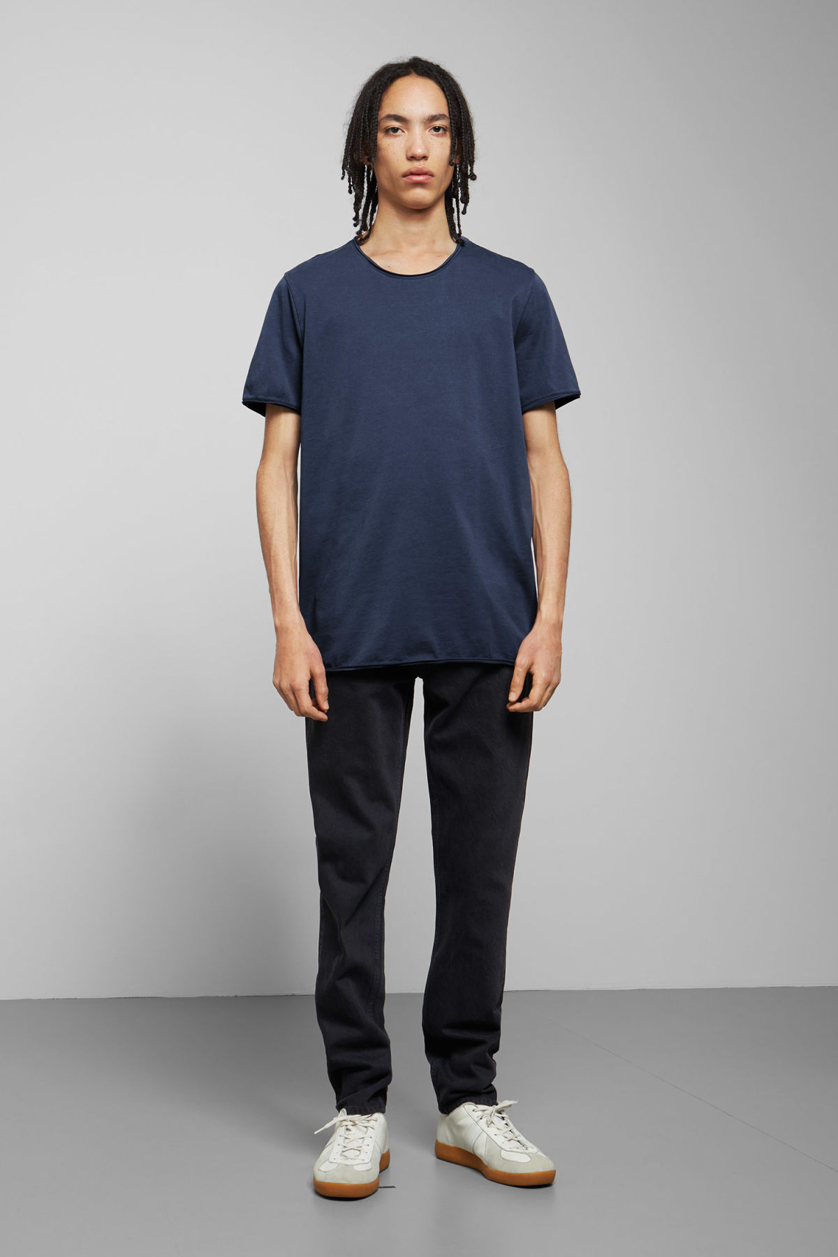 Model side image of Weekday dark t-shirt in blue