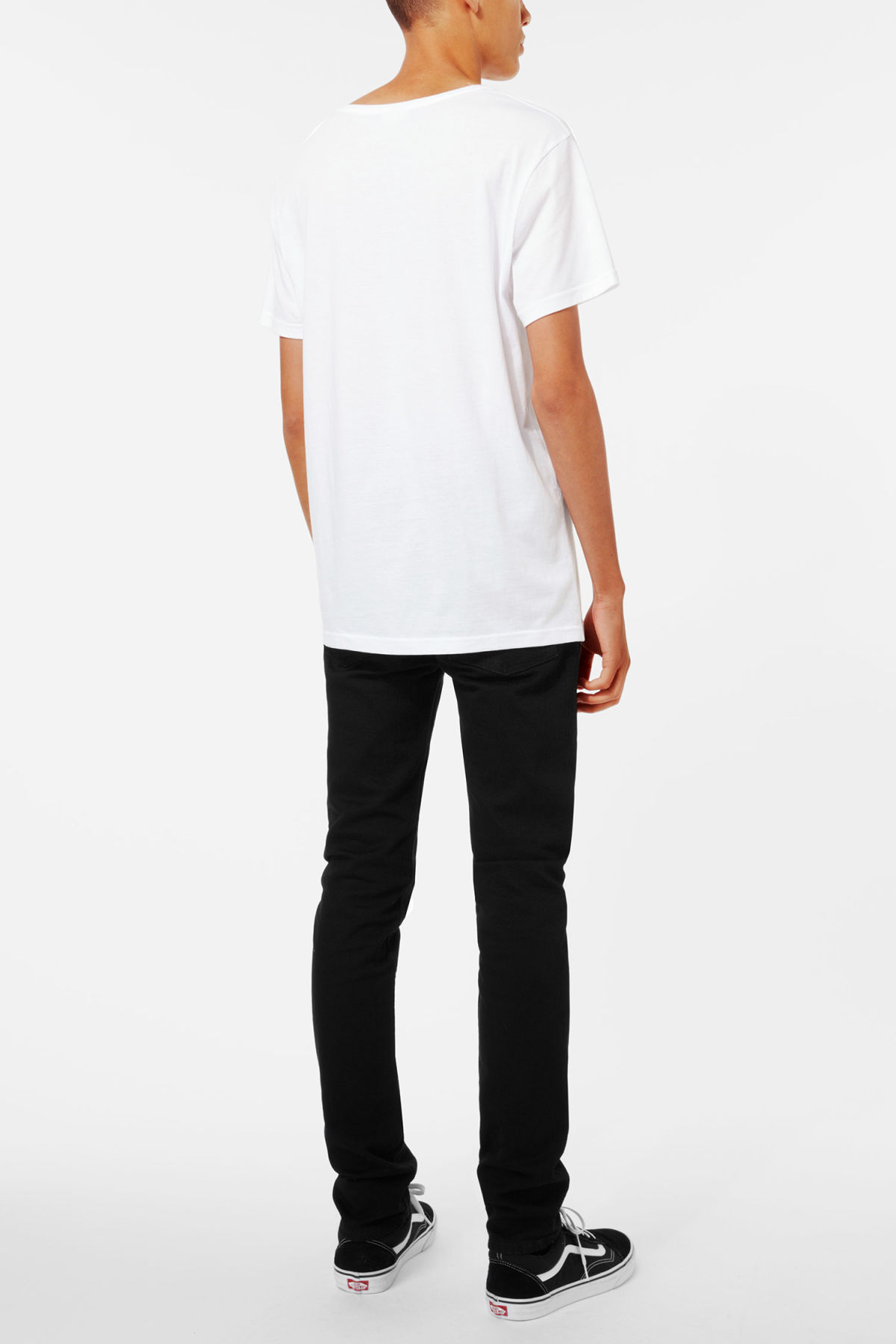 Model side image of Weekday daniel t-shirt in white