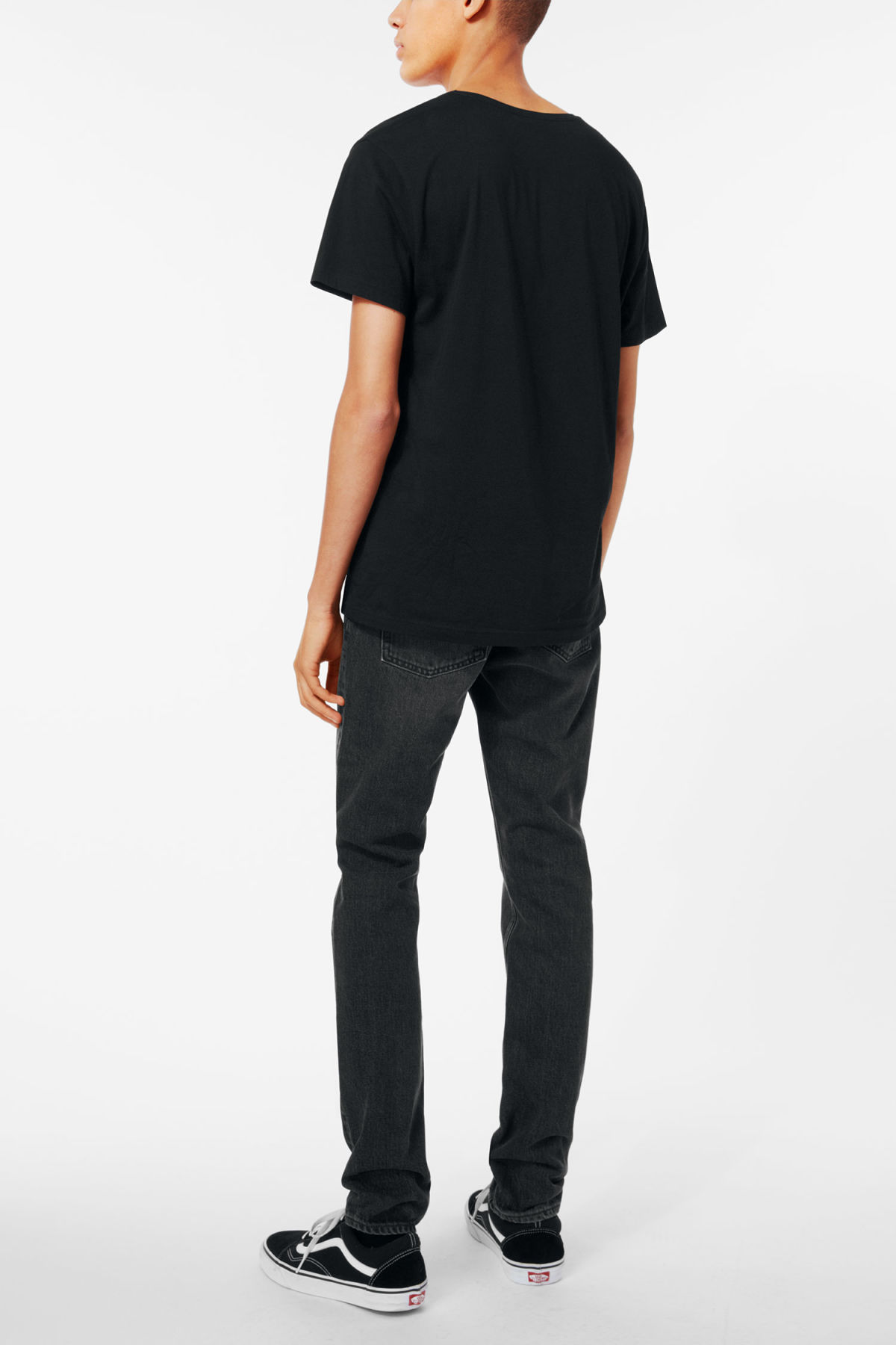 Model side image of Weekday daniel t-shirt in black