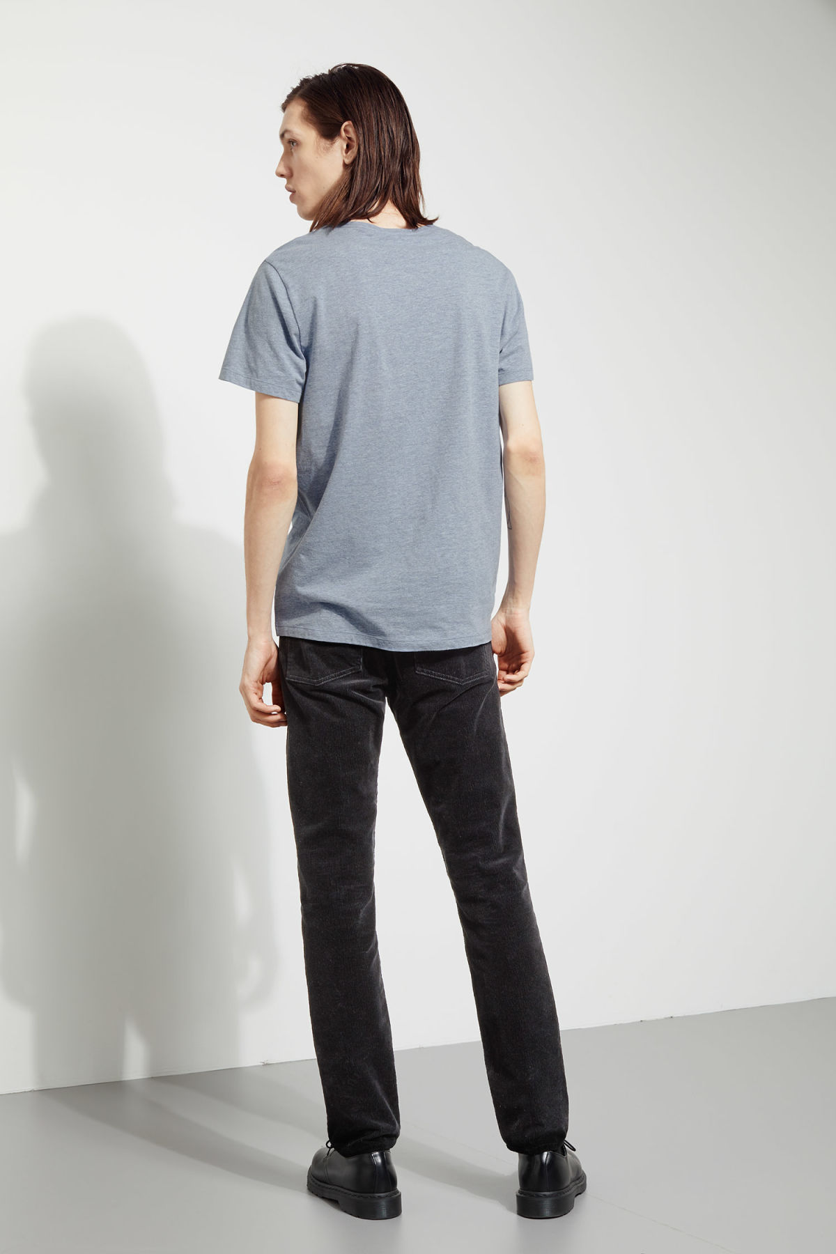 Model side image of Weekday daniel t-shirt in blue