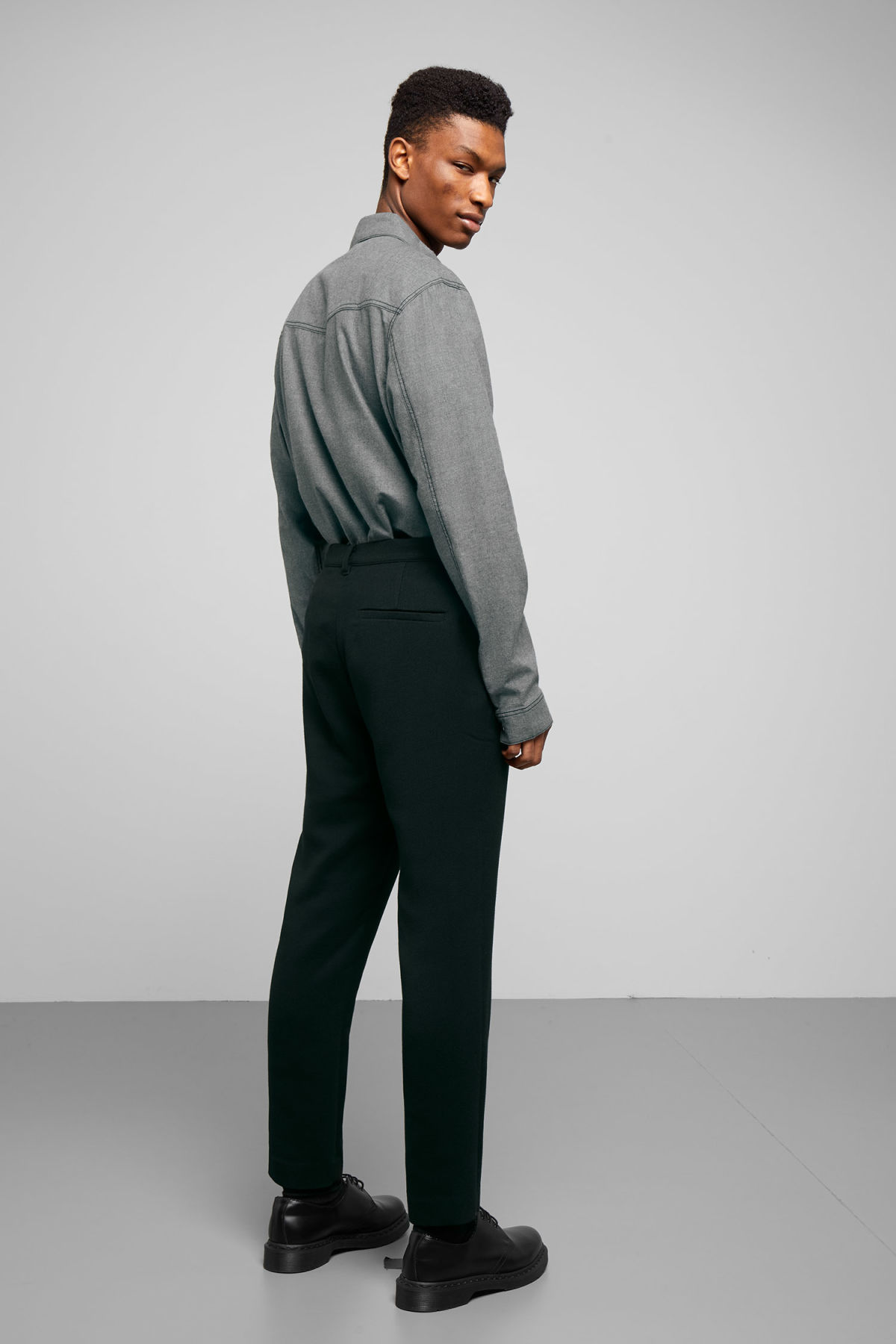 Model side image of Weekday arvid trousers in black