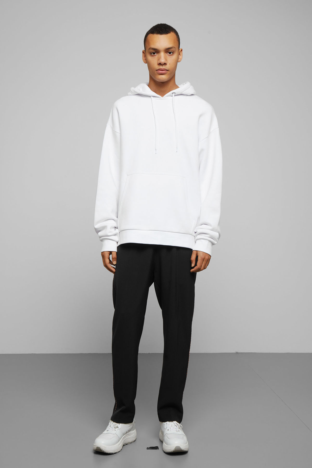 Model side image of Weekday big hawk hoodie in white