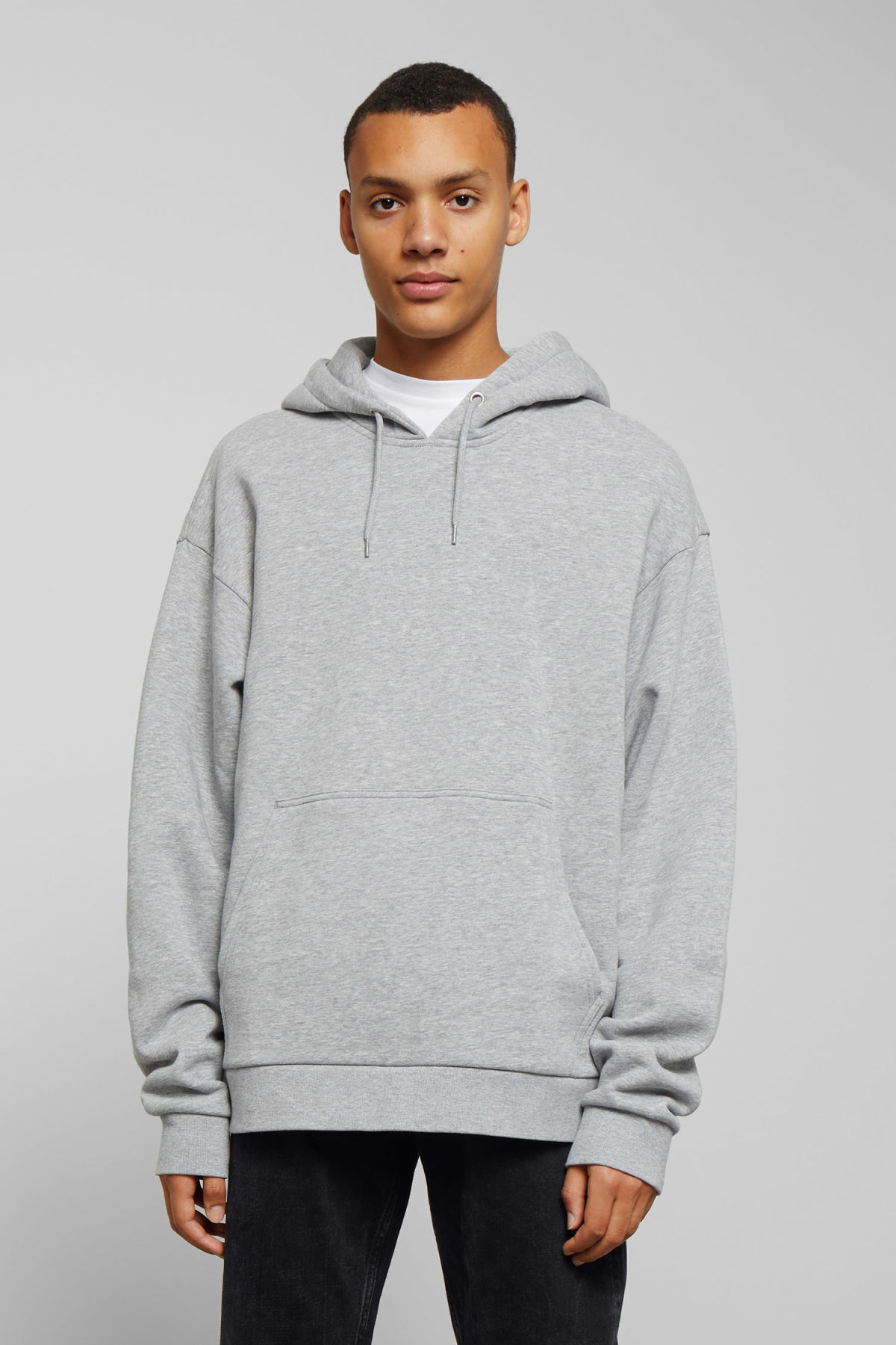 Model front image of Weekday big hawk hoodie in grey