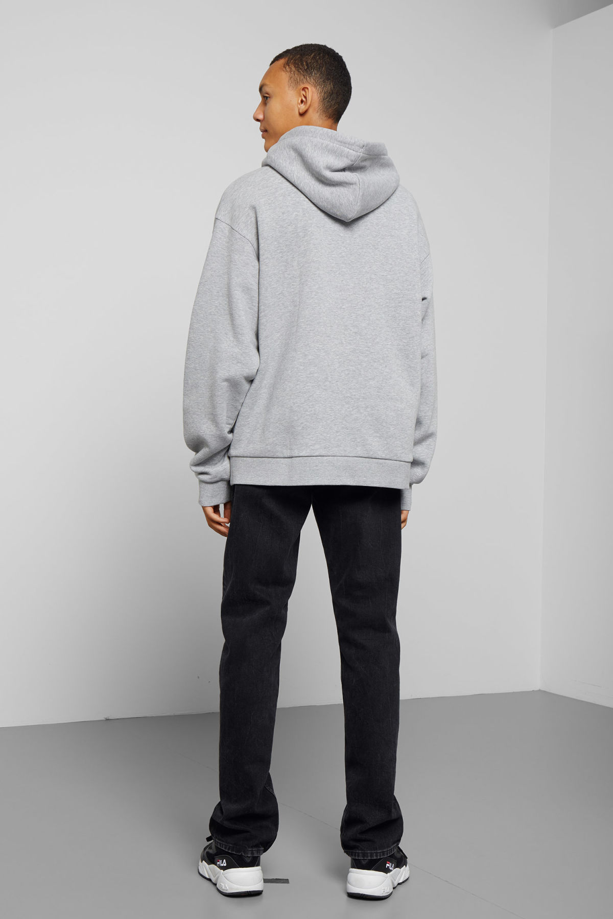 Model side image of Weekday big hawk hoodie in grey