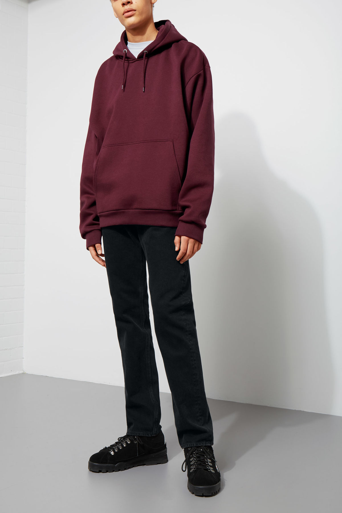 Model side image of Weekday big hawk hoodie in red