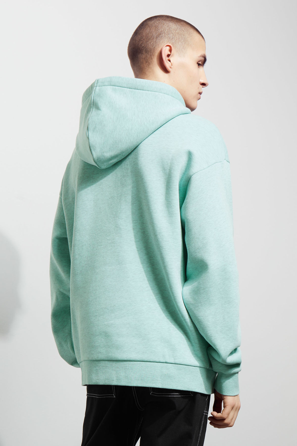Model back image of Weekday big hawk hoodie in turquoise