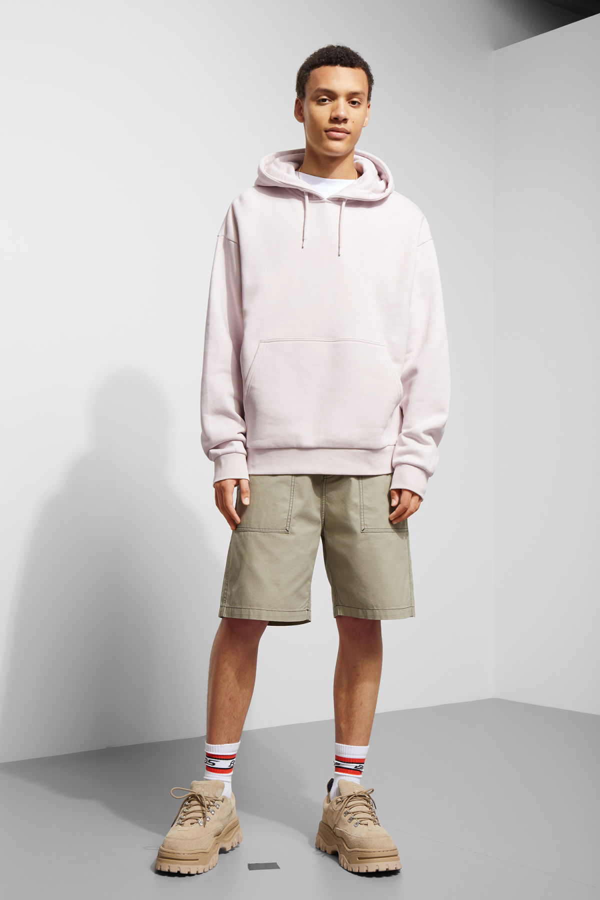Model side image of Weekday big hawk hoodie in purple